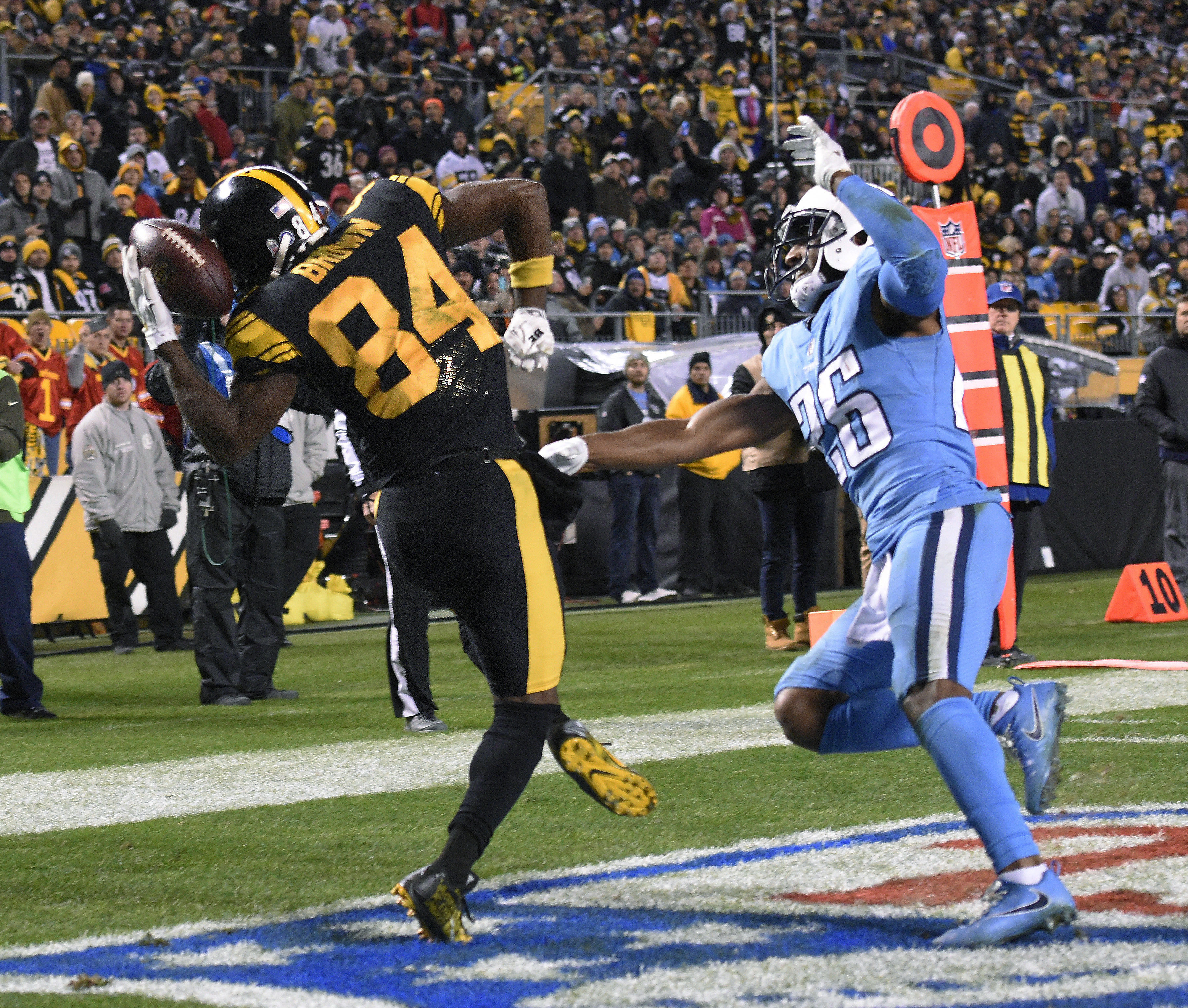 Who's stopping Antonio Brown when he catches balls with his helmet?