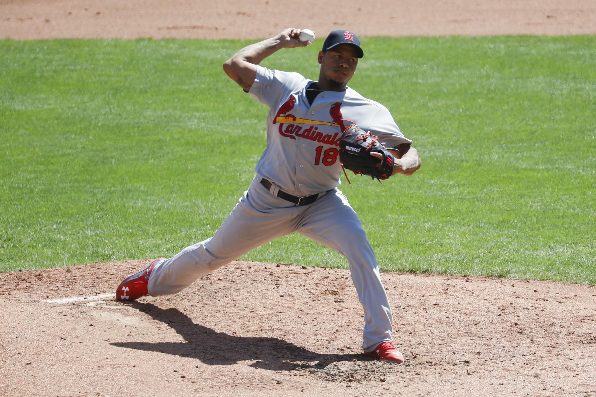 Martinez's Arm, Bat Help Cardinals to 5-3 Win Over Rockies