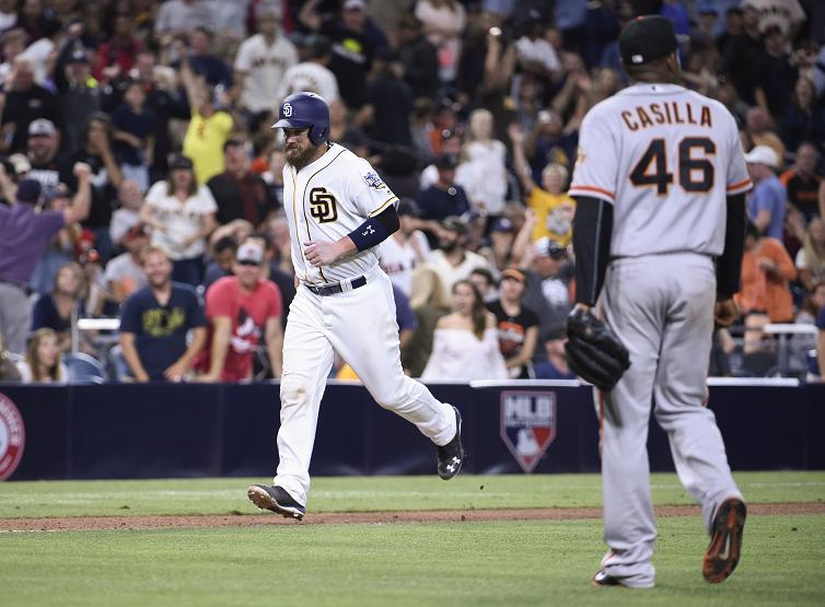 Santiago Casilla walks off after balking home the winning run. (Getty Images)
