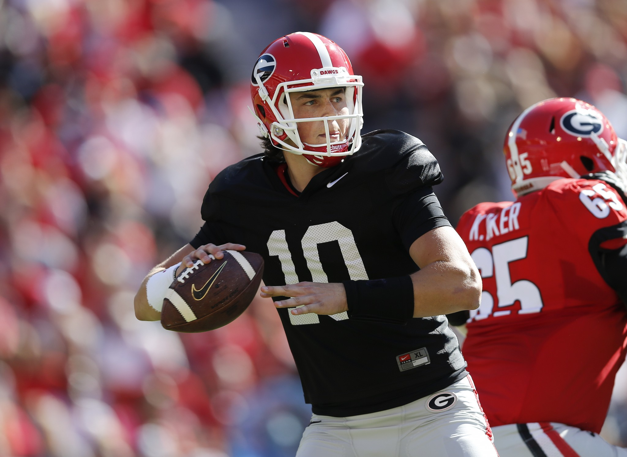 In this April 16, 2016, file photo, Georgia quarterback Jacob Eason throws during the first half of their spring intrasquad NCAA college football game in Athens, Ga. Freshman Jacob Eason, the biggest prize in Kirby Smart's first recruiting class, should eventually take over at quarterback. (AP Photo/John Bazemore, File)