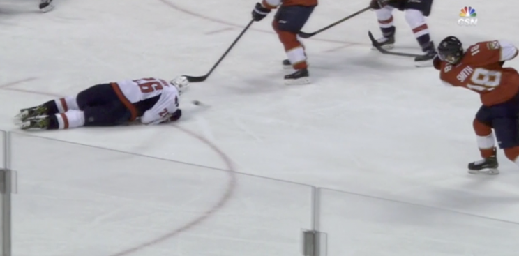 Daniel Winnik loses chunk of ear on nasty blocked shot (Video)