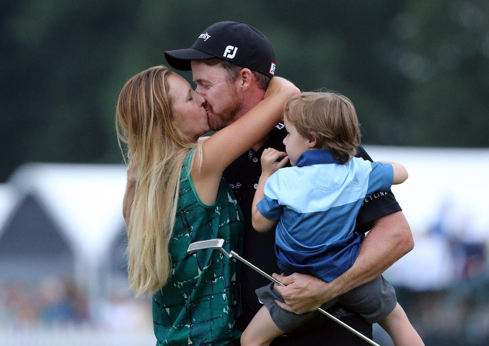 Jimmy Walker celebrates with his wife Erin, left, and son Beckett after winning the PGA Championship. (AP)