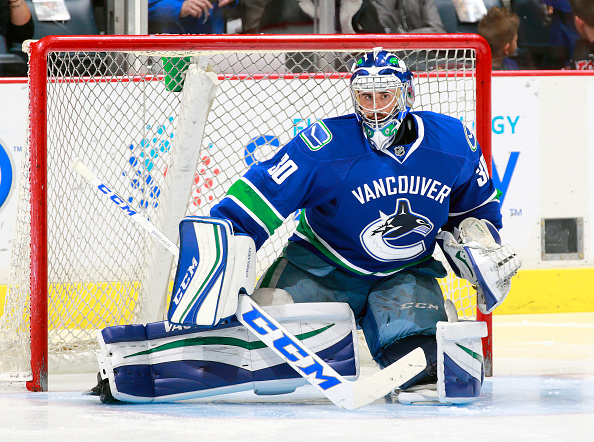 VANCOUVER, BC - OCTOBER 15: Ryan Miller #30 of the Vancouver Canucks looks on from his crease during their NHL game against the Calgary Flames at Rogers Arena October 15, 2016 in Vancouver, British Columbia, Canada. (Photo by Jeff Vinnick/NHLI via Getty Images)