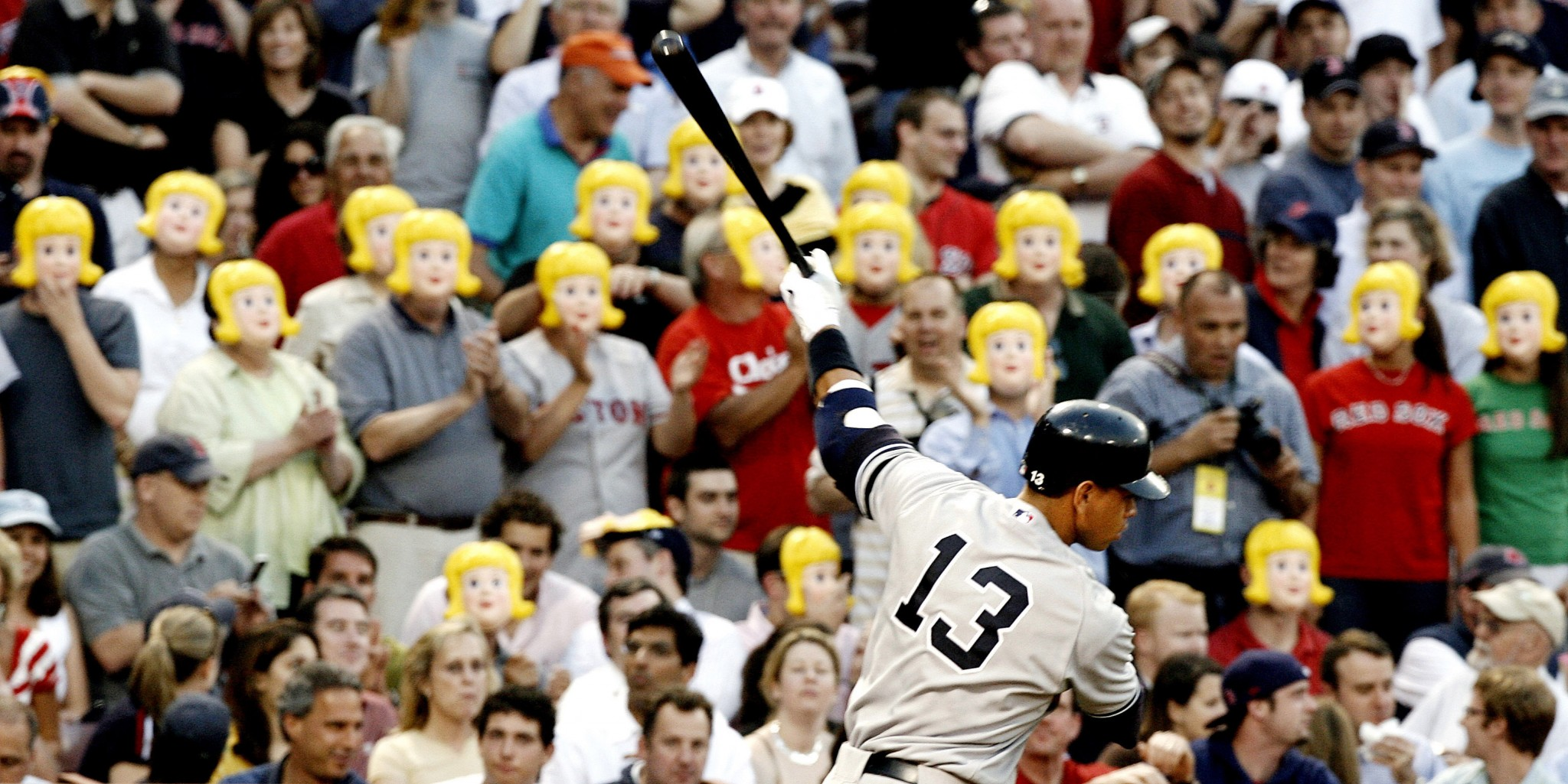 Red Sox fans mock A-Rod with masks. (AP)