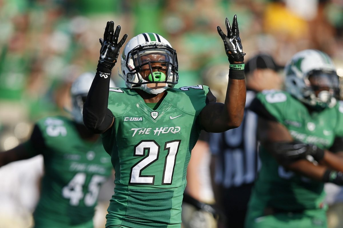 HUNTINGTON, WV - SEPTEMBER 6: Tiquan Lang #21 of the Marshall Thundering Herd celebrates in the second half against the Purdue Boilermakers at Joan C. Edwards Stadium on September 6, 2015 in Huntington, West Virginia. Marshall defeated Purdue 41-31. (Photo by Joe Robbins/Getty Images)