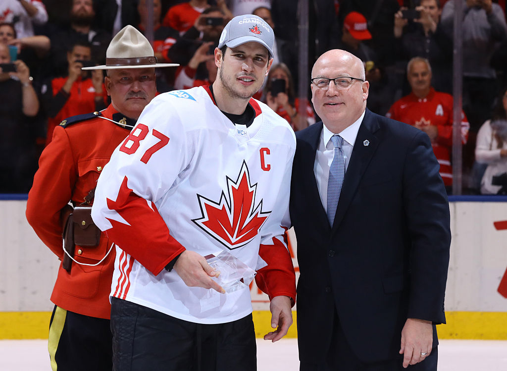 TORONTO, ON - SEPTEMBER 29: Bill Daly presents Sidney Crosby #87 of Team Canada with the World Cup of Hockey Championship MVP trophy after his teams win over Team Europe during Game Two of the World Cup of Hockey final series at the Air Canada Centre on September 29, 2016 in Toronto, Canada. The Team Canada defeated Team Europe 2-1. (Photo by Bruce Bennett/Getty Images)