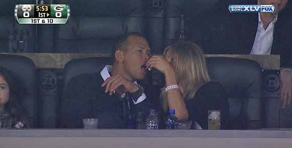 A-Rod gets popcorn fed to him at the Super Bowl. (Fox)