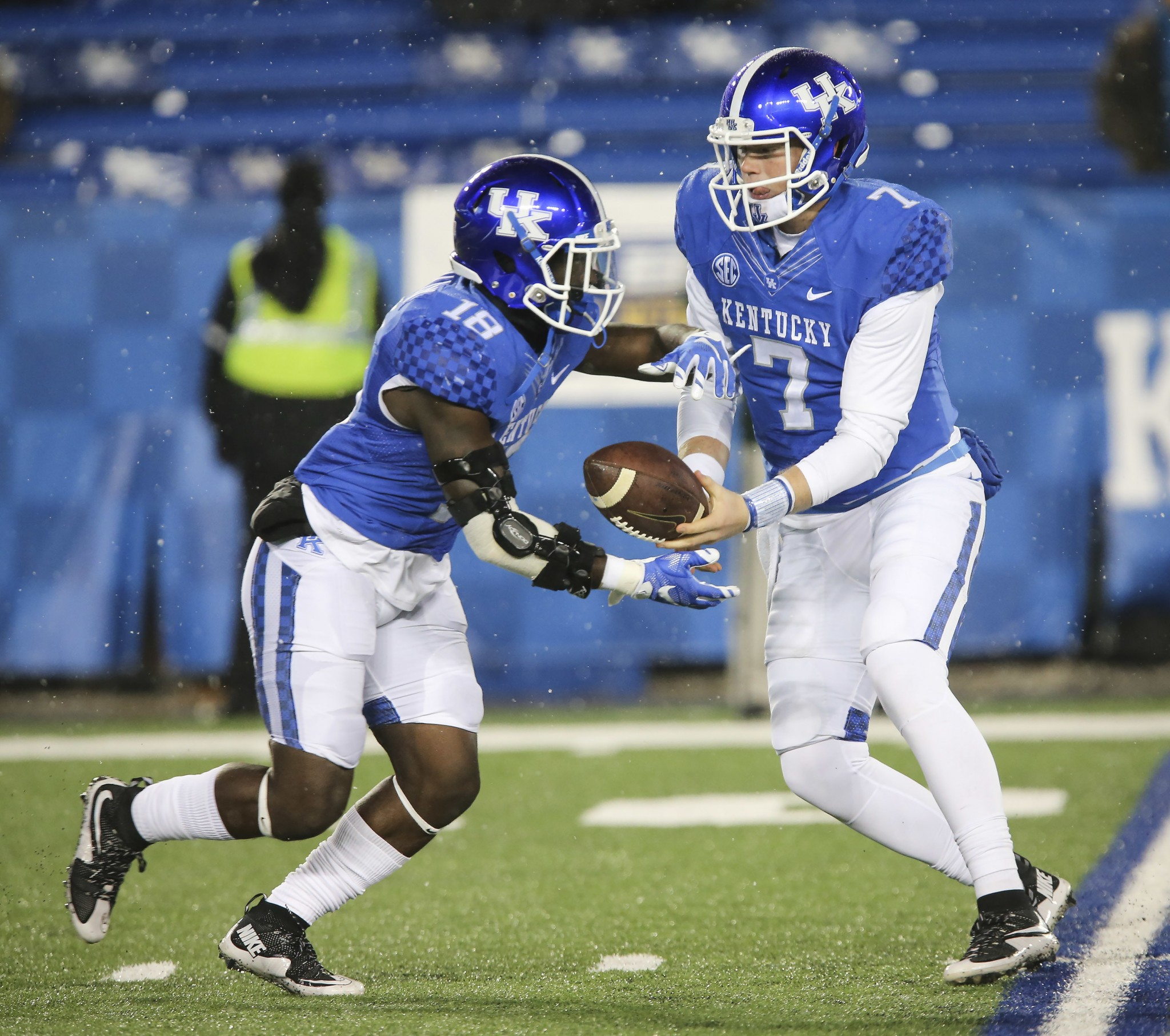 In this Nov. 21, 2015, file photo, Kentucky quarterback Drew Barker hands off the ball to running back Stanley Williams during the second half of an NCAA college football game against Charlotte in Lexington, Ky. (AP Photo/David Stephenson, File)