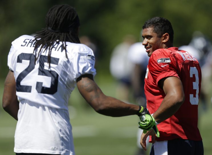 Russell Wilson and Richard Sherman have been Seahawks teammates since 2012. (AP)