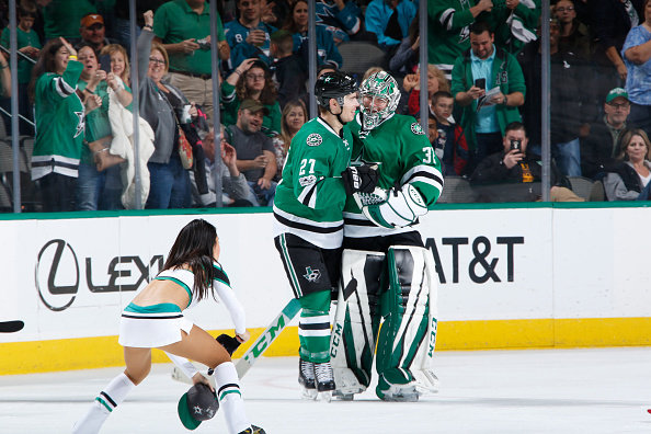 DALLAS, TX - MARCH 24: Kari Lehtonen #32 and Adam Cracknell #27 of the Dallas Stars celebrate a goal for his first career hat-trick against the San Jose Sharks at the American Airlines Center on March 24, 2017 in Dallas, Texas. (Photo by Glenn James/NHLI via Getty Images)