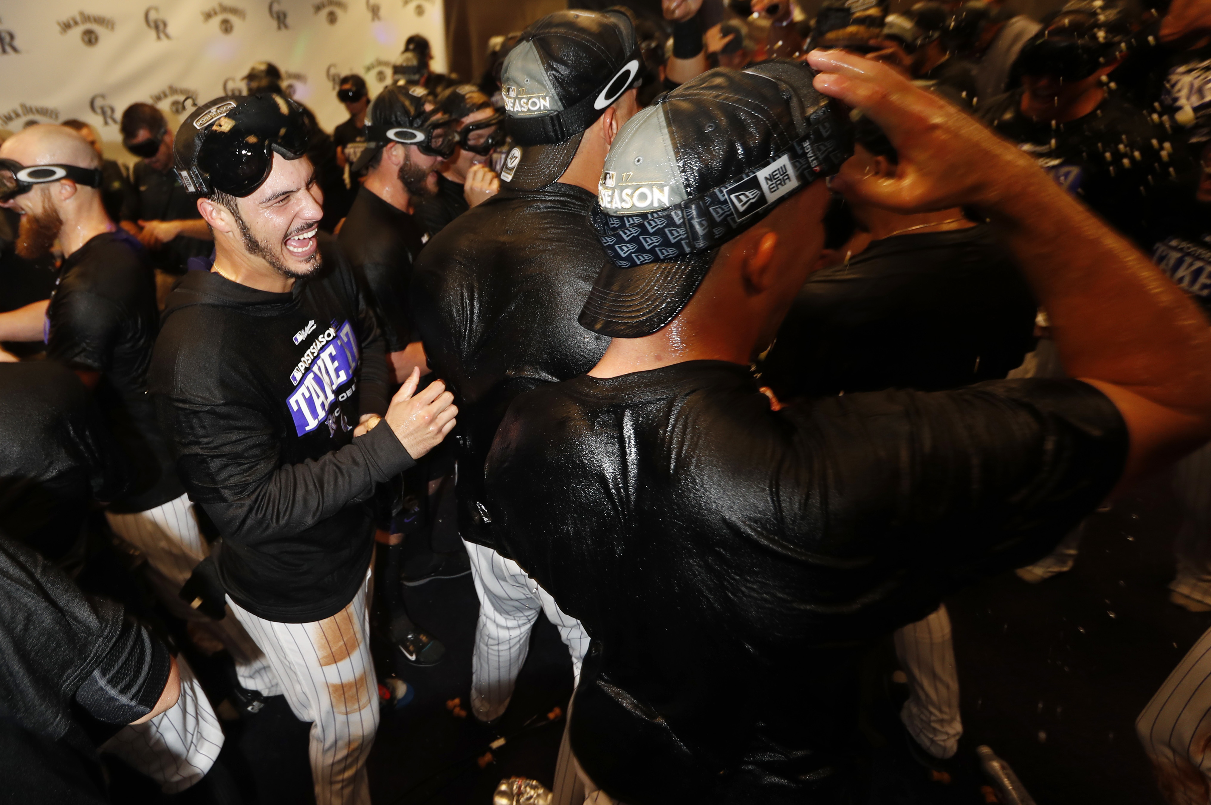 Rockies celebrate wild-card clinch by jumping in Coors Field fountain