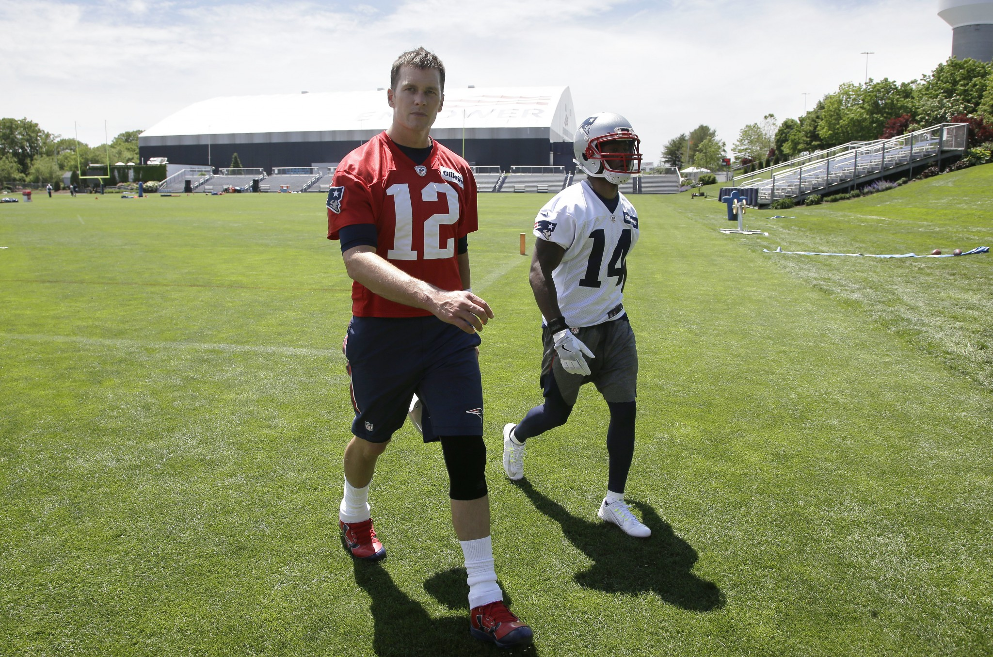 Summer chemistry class: new Patriots WR Brandin Cooks (right) has to learn how to work well with Tom Brady. (AP)