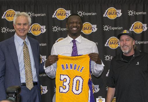 Julius Randle learns that Jim Buss always wears a hat. (AP Photo/Damian Dovarganes)