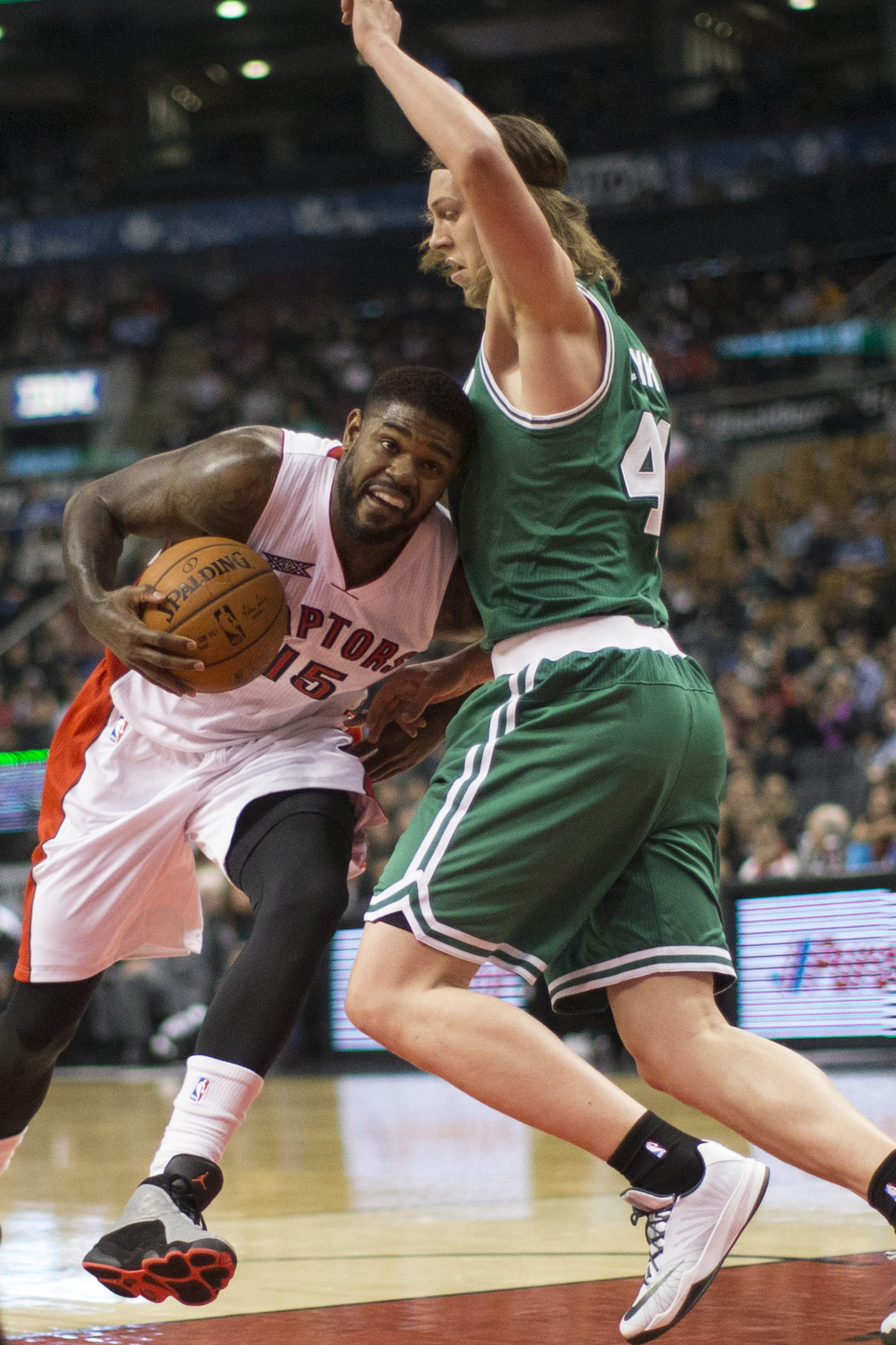 Amir Johnson nuzzles future teammate Kelly Olynyk. (AP Photo/The Canadian Press, Chris Young)