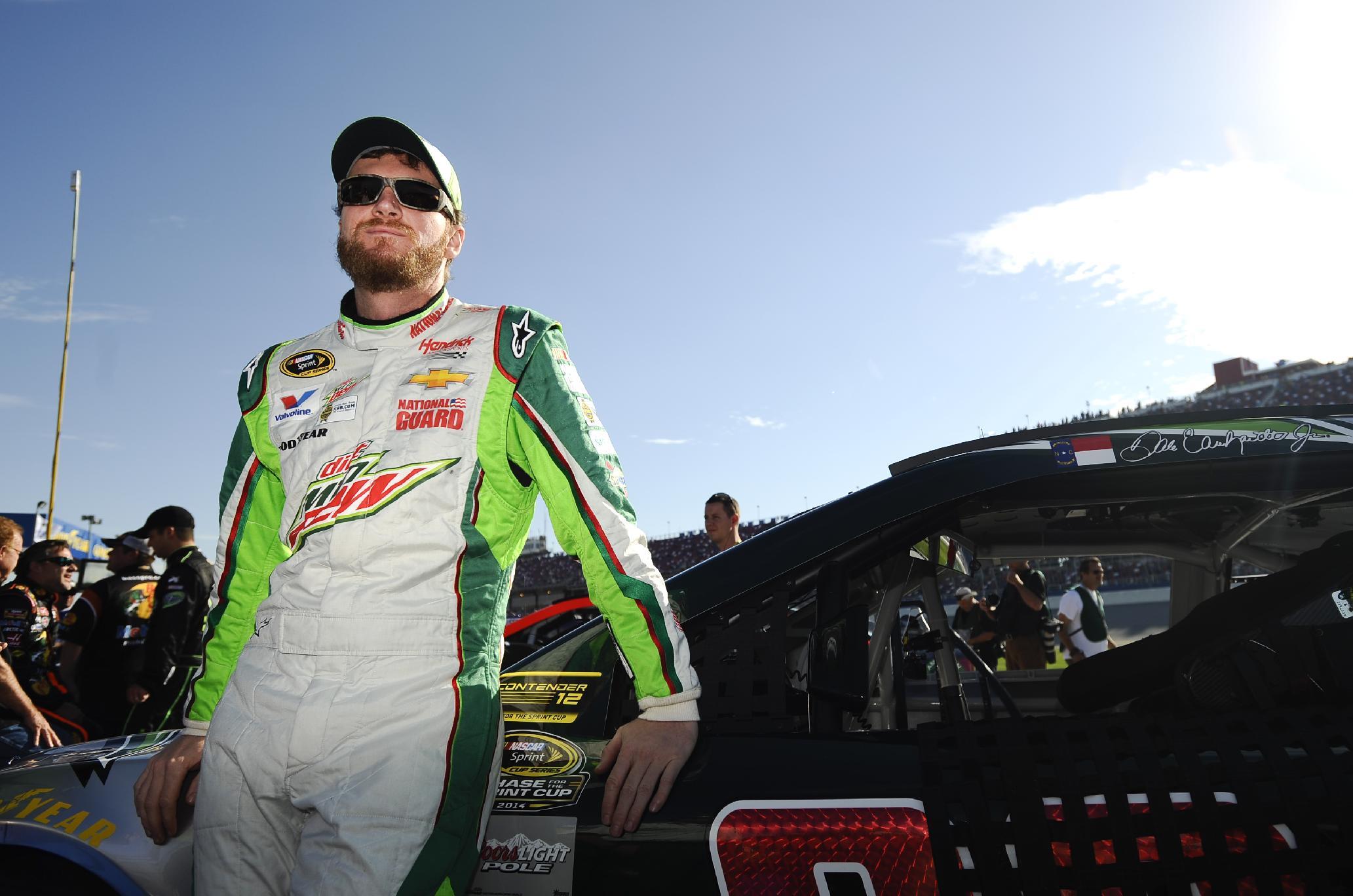 Dale Earnhardt Jr., waits  to qualify for Sunday's  NASCAR Sprint Cup Series auto race at Talladega Superspeedway Saturday, Oct. 18, 2014, in Talladega, Ala.  (AP Photo/Rainier Ehrhardt)