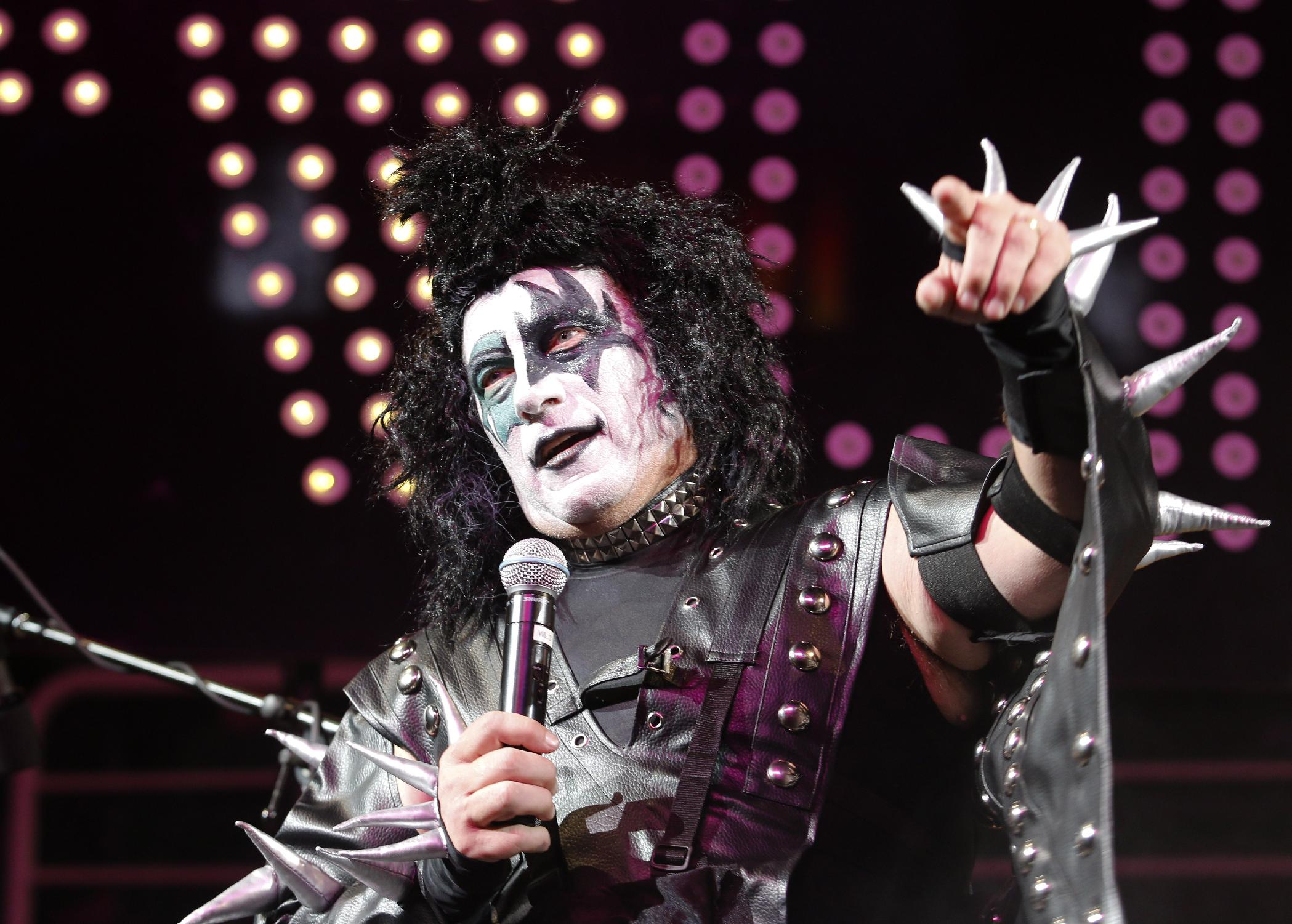 Tom Izzo talks to the crowd while dressed as a member of the band Kiss (AP)