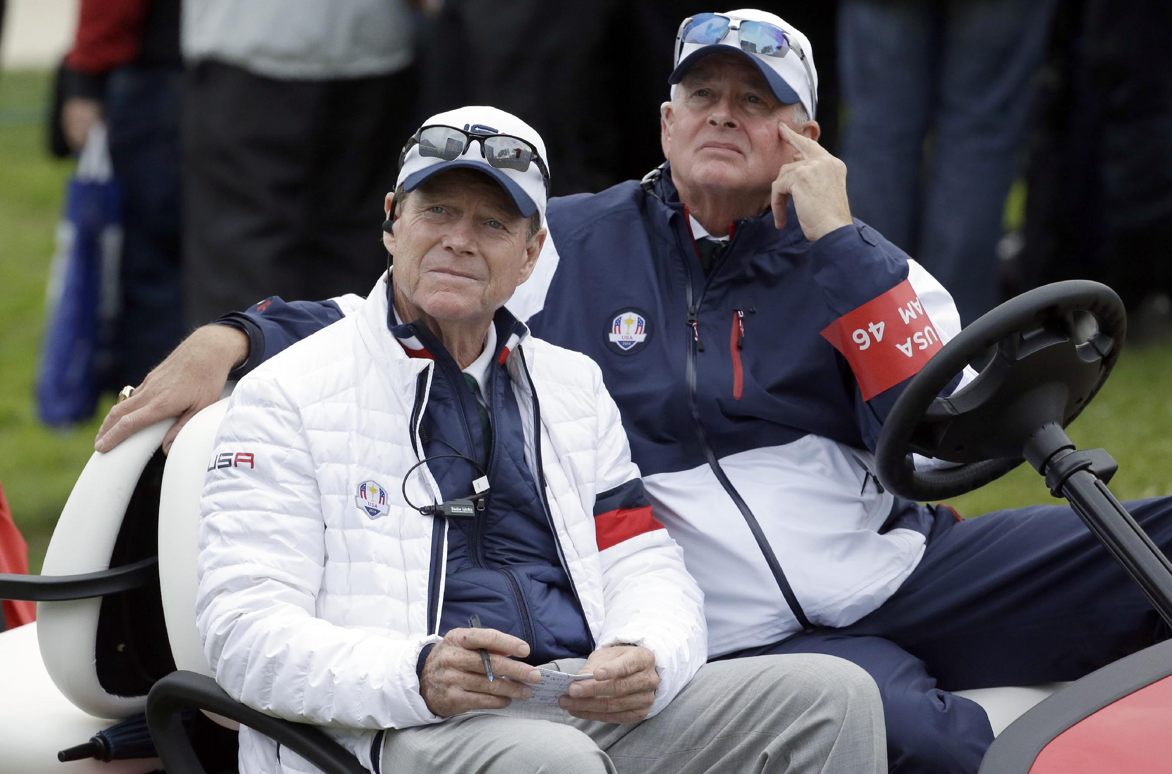 US team captain Tom Watson, left, sits in a buggy and looks at the scoreboard near the 11th hole during the singles match on the final day of the Ryder Cup golf tournament at Gleneagles, Scotland, Sunday, Sept. 28, 2014. Unidentified man at right. (AP Photo/Matt Dunham)