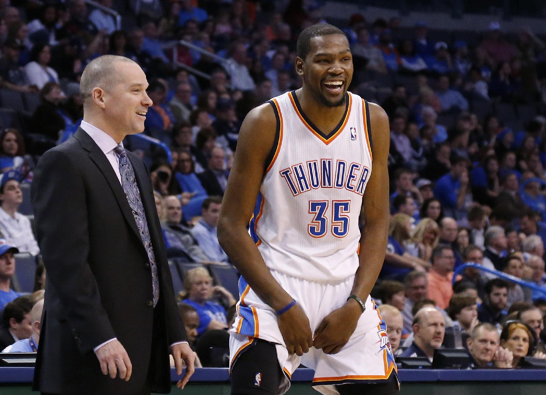 Kevin Durant laughs off the small stuff. (AP/Sue Ogrocki)