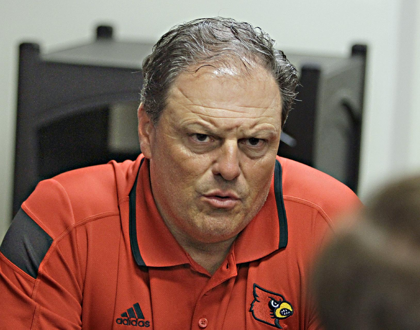 Louisville defensive coordinator Todd Grantham discusses the first week of practice for the Cardinals. Saturday, Aug. 9, 2014.  (AP Photo/Garry Jones)