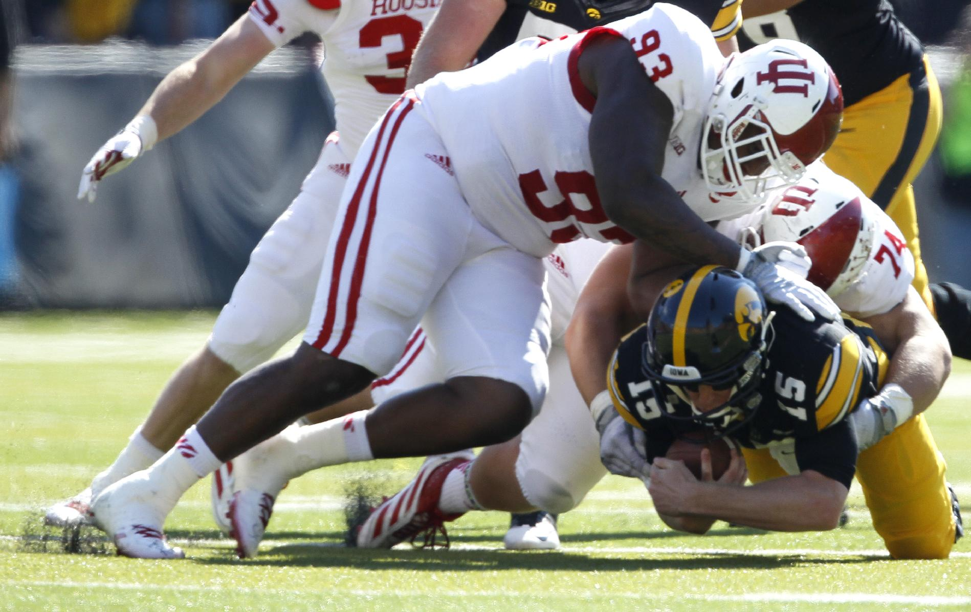 Indiana defensive tackle Ralph Green III, left, and defensive tackle Nate Hoff, right, sack Iowa quarterback Jake Rudock during the first half of an NCAA college football game Saturday, Oct. 11, 2014, in Iowa City, Iowa. (AP Photo/Matthew Putney)