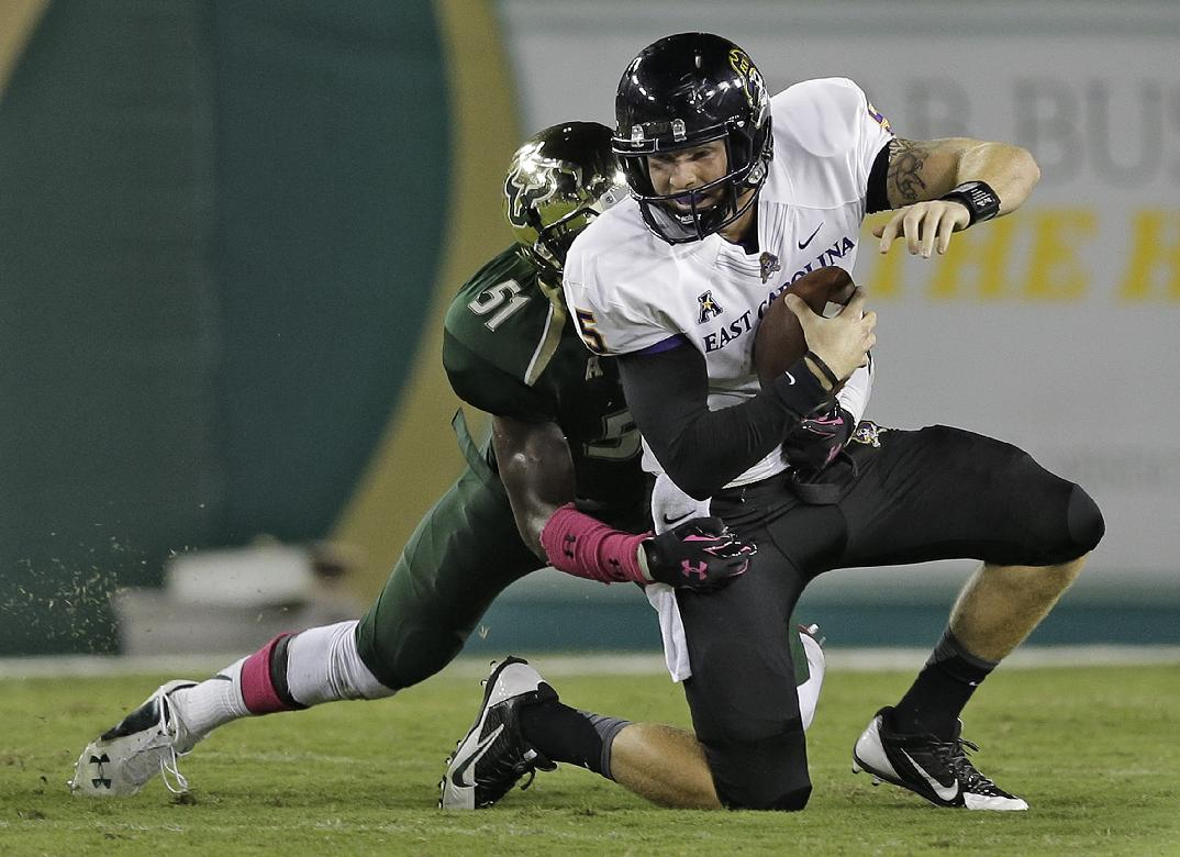 East Carolina quarterback Shane Carden (5) is sacked by South Florida linebacker Tashon Whitehurst (51) during the second quarter of an NCAA college football game Saturday, Oct. 11, 2014, in Tampa, Fla. (AP Photo/Chris O'Meara)