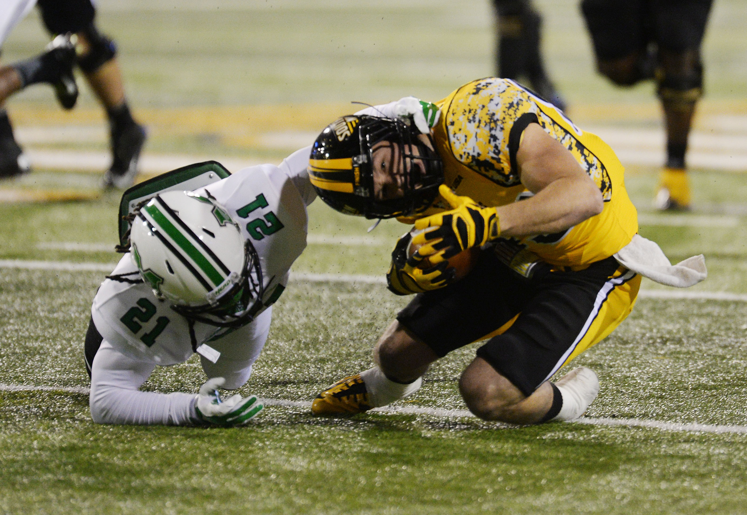 Southern Mississippi's Cooper Harrington (83) gets tackled by Marshall safety Tiquan Lang (21). (AP Photo/Steve Coleman)