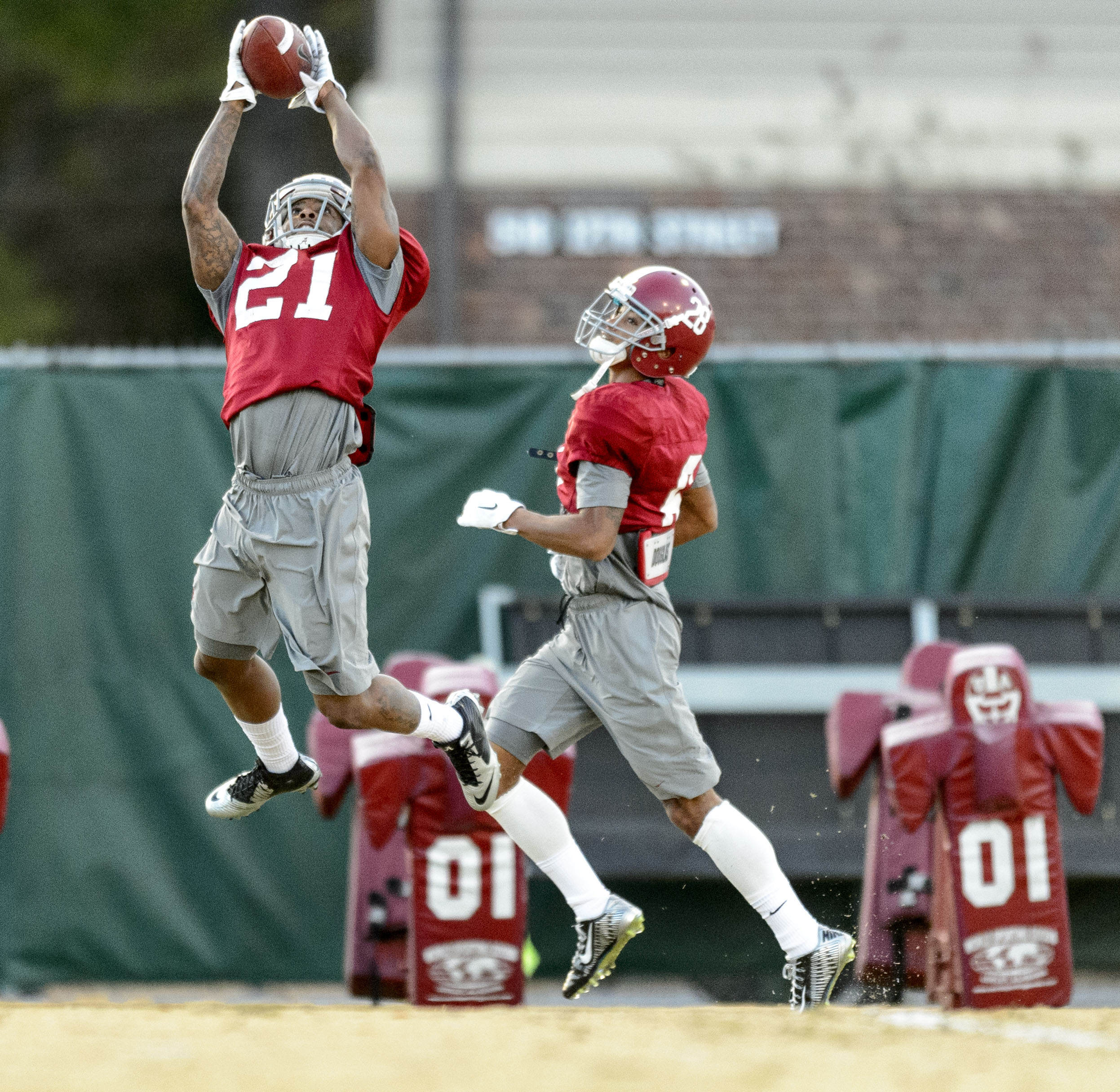 Alabama defensive back Maurice Smith (21) and Alabama defensive back Anthony Averett (28) work through drills during an Alabama NCAA college football practice, Monday, Nov. 24, 2014, at the Thomas-Drew Practice Facility in Tuscaloosa, Ala. (AP Photo/AL.com, Vasha Hunt)