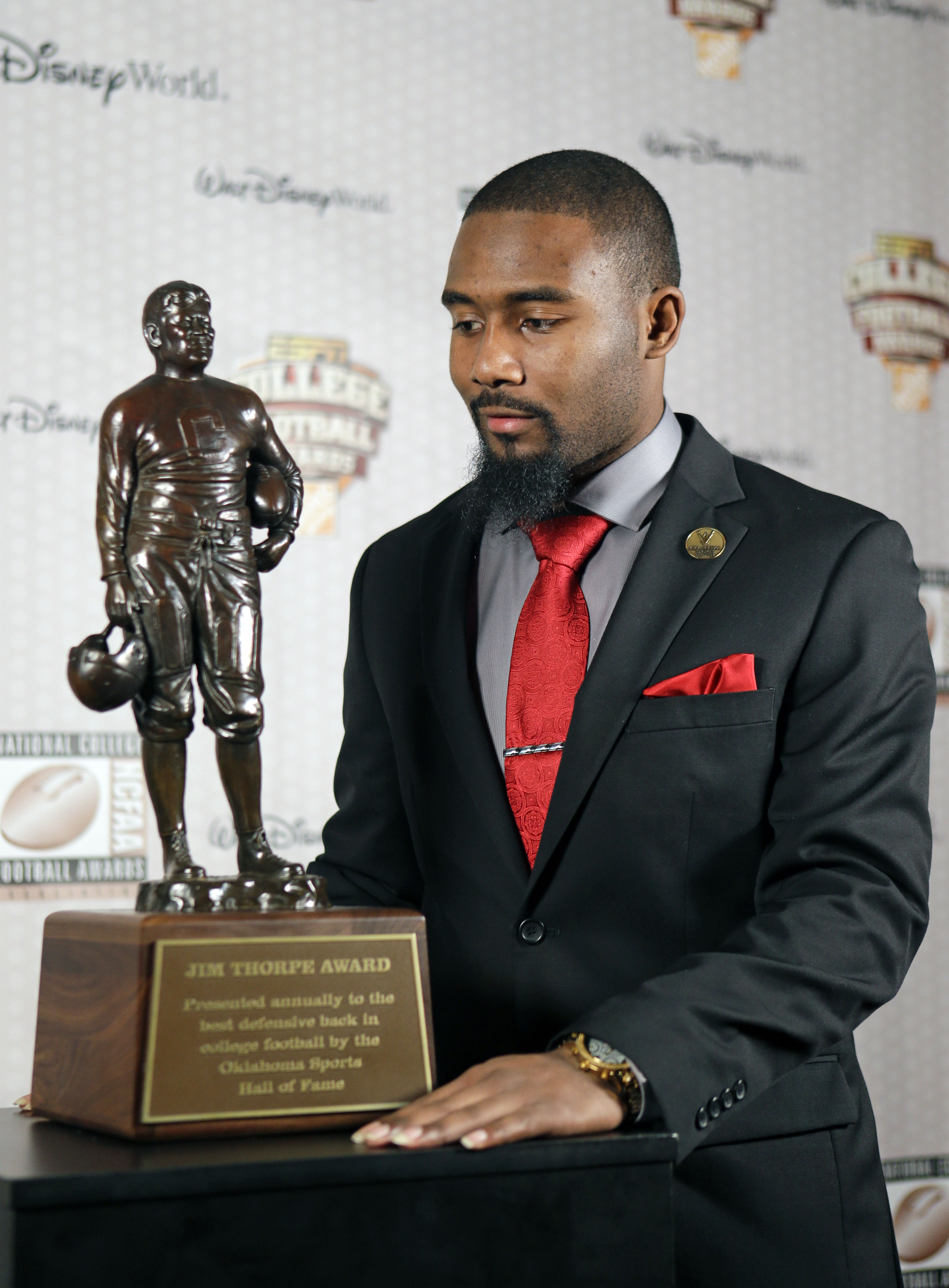 Louisville's Gerod Holliman stands with the Jim Thorpe Award (AP Photo/John Raoux)