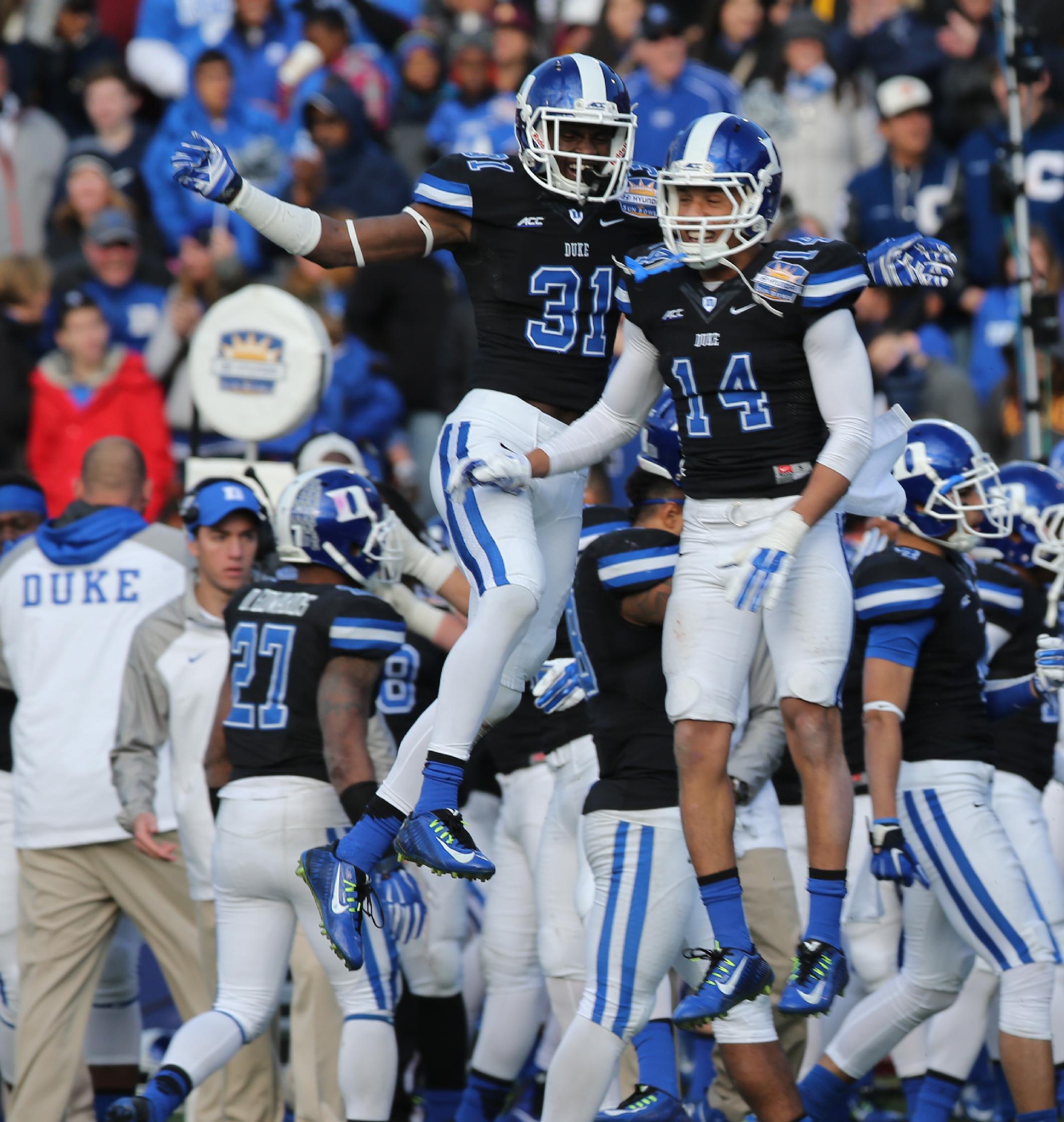 Duke's Breon Borders, left, and Bryon Fields celebrate stopping Arizona State on fourth down during the fourth quarter of the Sun Bowl NCAA college football game, Saturday, Dec. 27, 2014, in El Paso, Texas. (AP Photo/Victor Calzada)