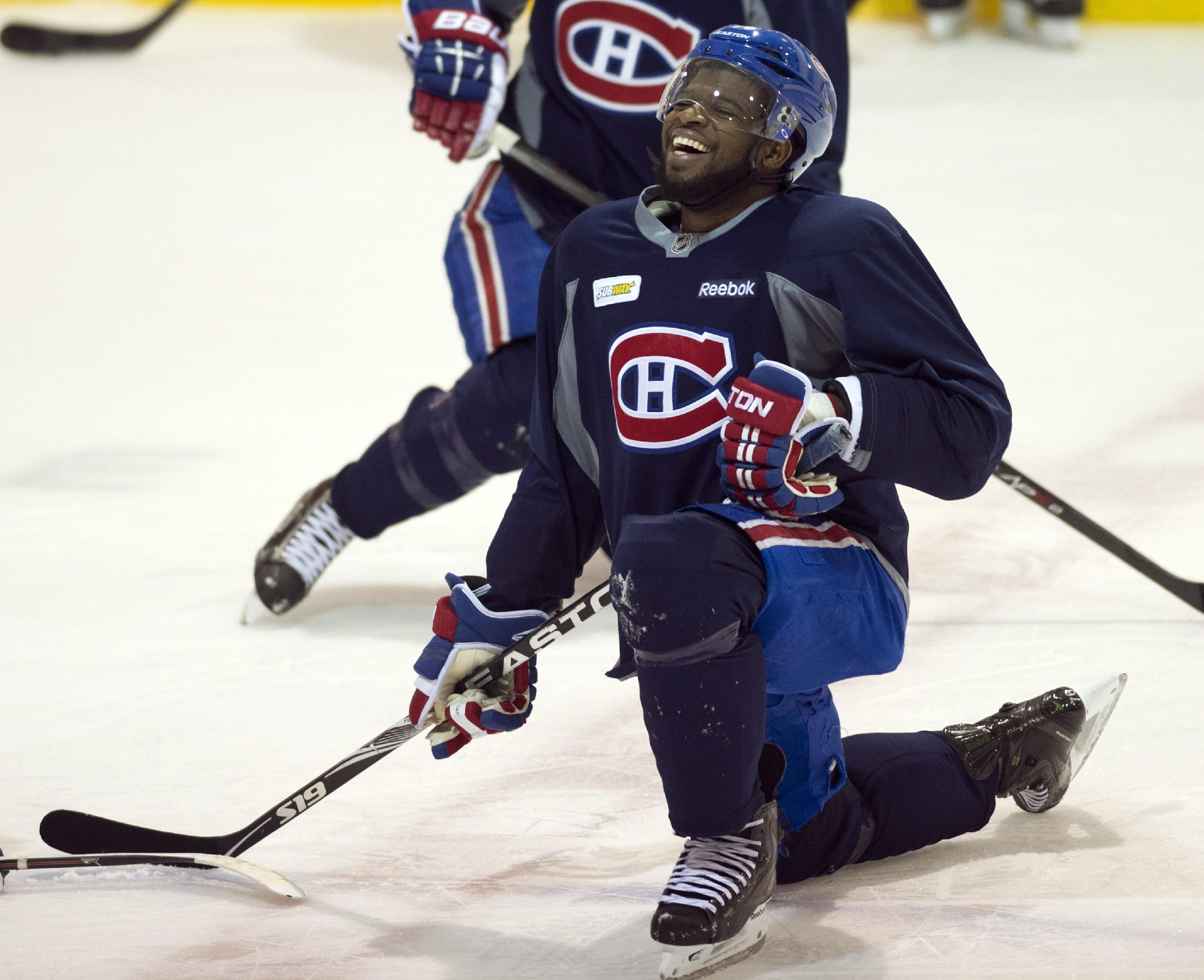 Montreal Canadiens defenseman P.K. Subban has a laugh as he stretches  during NHL hockey practice Friday 6dff7e002
