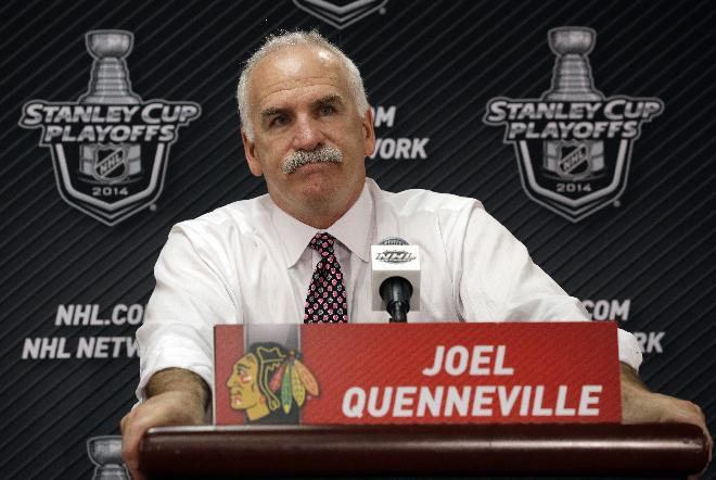 Chicago Blackhawks head coach Joel Quenneville talks to the reporters during a news conference after Los Angeles Kings defeated the Blackhawks 5-4 in the overtime period in Game 7 of the Western Conference finals in the NHL hockey Stanley Cup playoffs Sunday, June 1, 2014, in Chicago. (AP Photo/Nam Y. Huh)