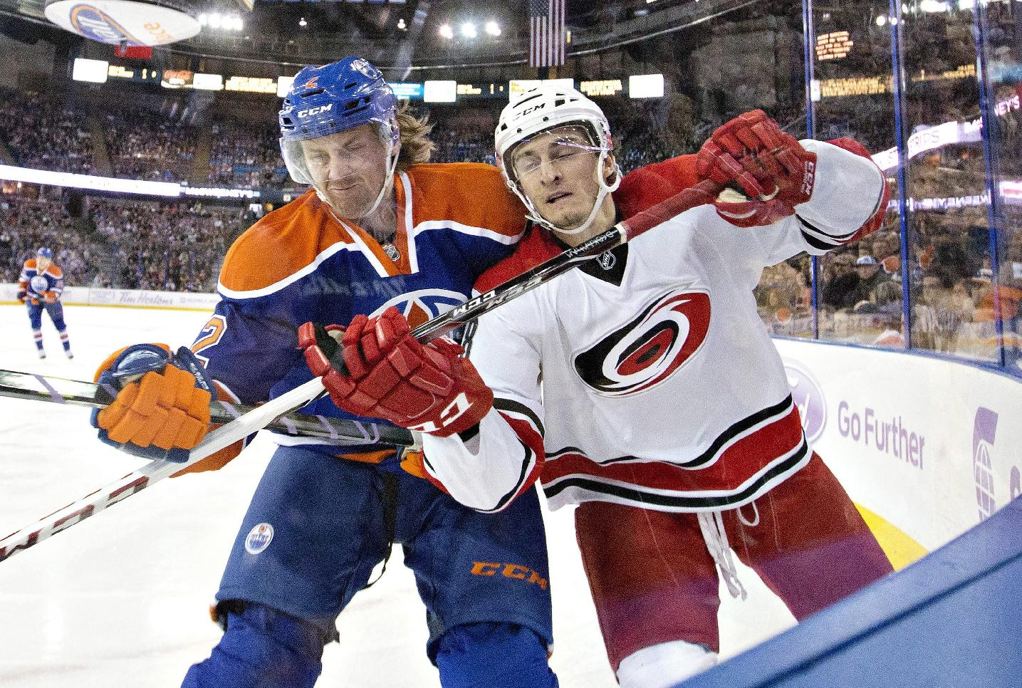 Carolina Hurricanes' Alexander Semin, right, is checked by Edmonton Oilers' Jeff Petry during the first period of an NHL hockey game Friday, Oct. 24, 2014, in Edmonton, Alberta. (AP Photo/The Canadian Press, Jason Franson)