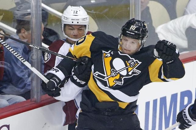 Pittsburgh Penguins' Christian Ehrhoff (10) checks Colorado Avalanche's Jarome Iginla (12) into the boards during the first period of an NHL hockey game in Pittsburgh on Thursday, Dec. 18, 2014. (AP Photo/Gene J. Puskar)