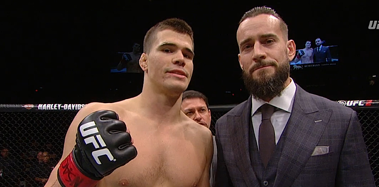 CM Punk will make his UFC debut against Mickey Gall on Sept. 10.