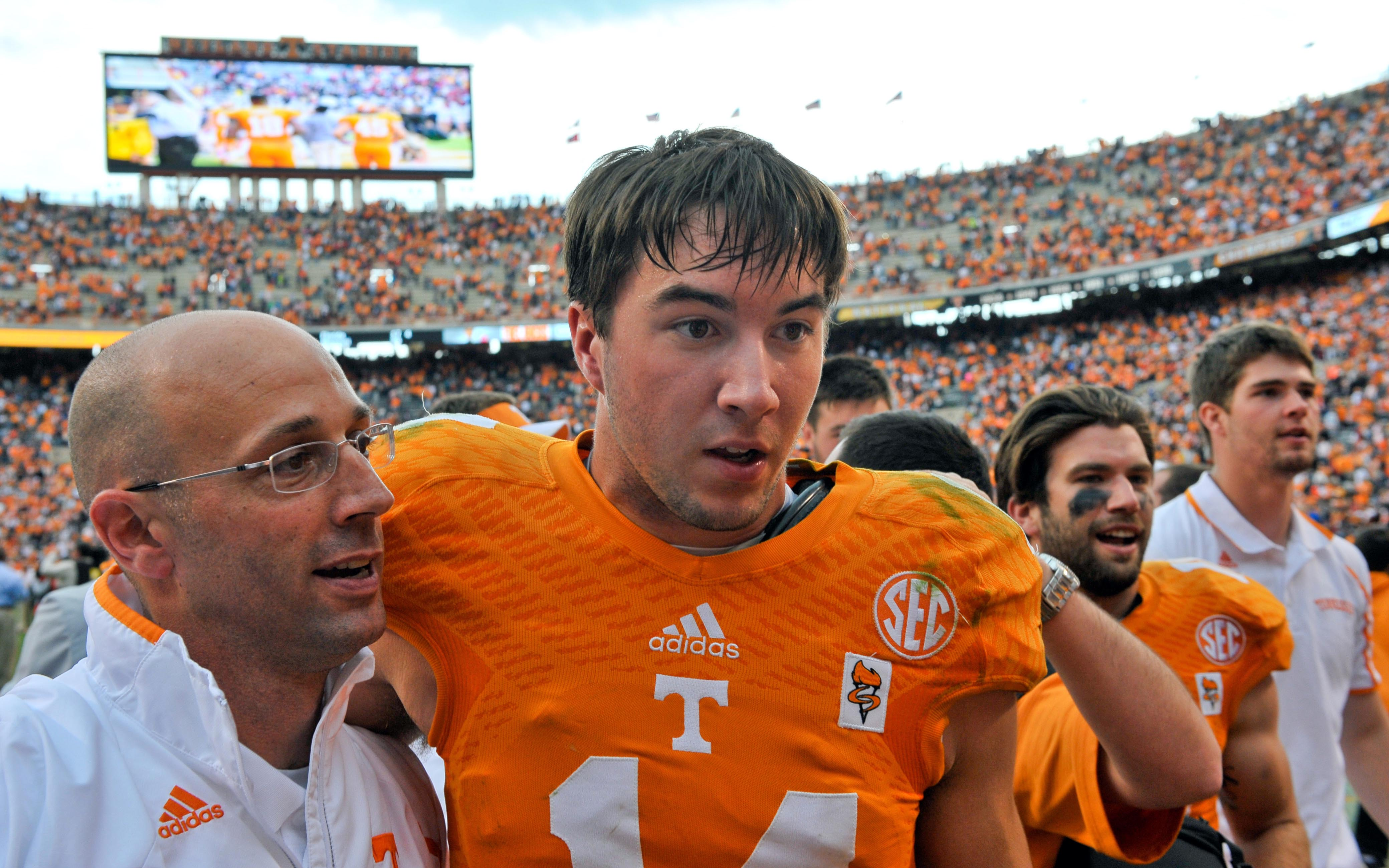 Oct 19, 2013; Knoxville, TN, USA; Tennessee Volunteers offensive coordinator Mike Bajakian congratulates Tennessee quarterback Justin Worley (14) after the game against the South Carolina Camecocks at Neyland Stadium. (Jim Brown-USA TODAY Sports)