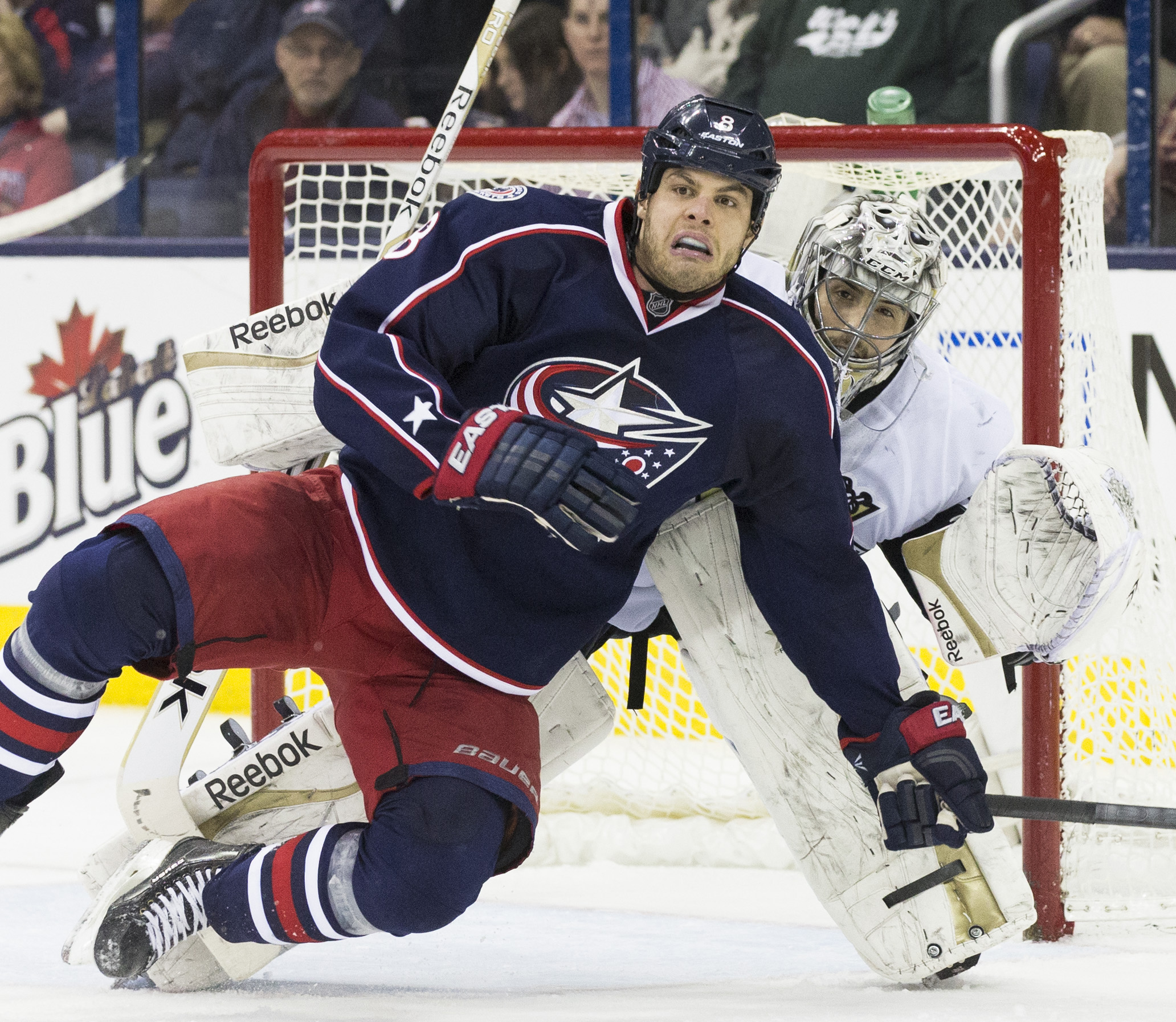 Mar 28, 2014; Columbus, OH, USA; Columbus Blue Jackets right wing Nathan Horton (8) falls on the ice in front of Pittsburgh Penguins goalie Marc-Andre Fleury (29) at Nationwide Arena. The Penguins won 2-1. (Greg Bartram-USA TODAY Sports)