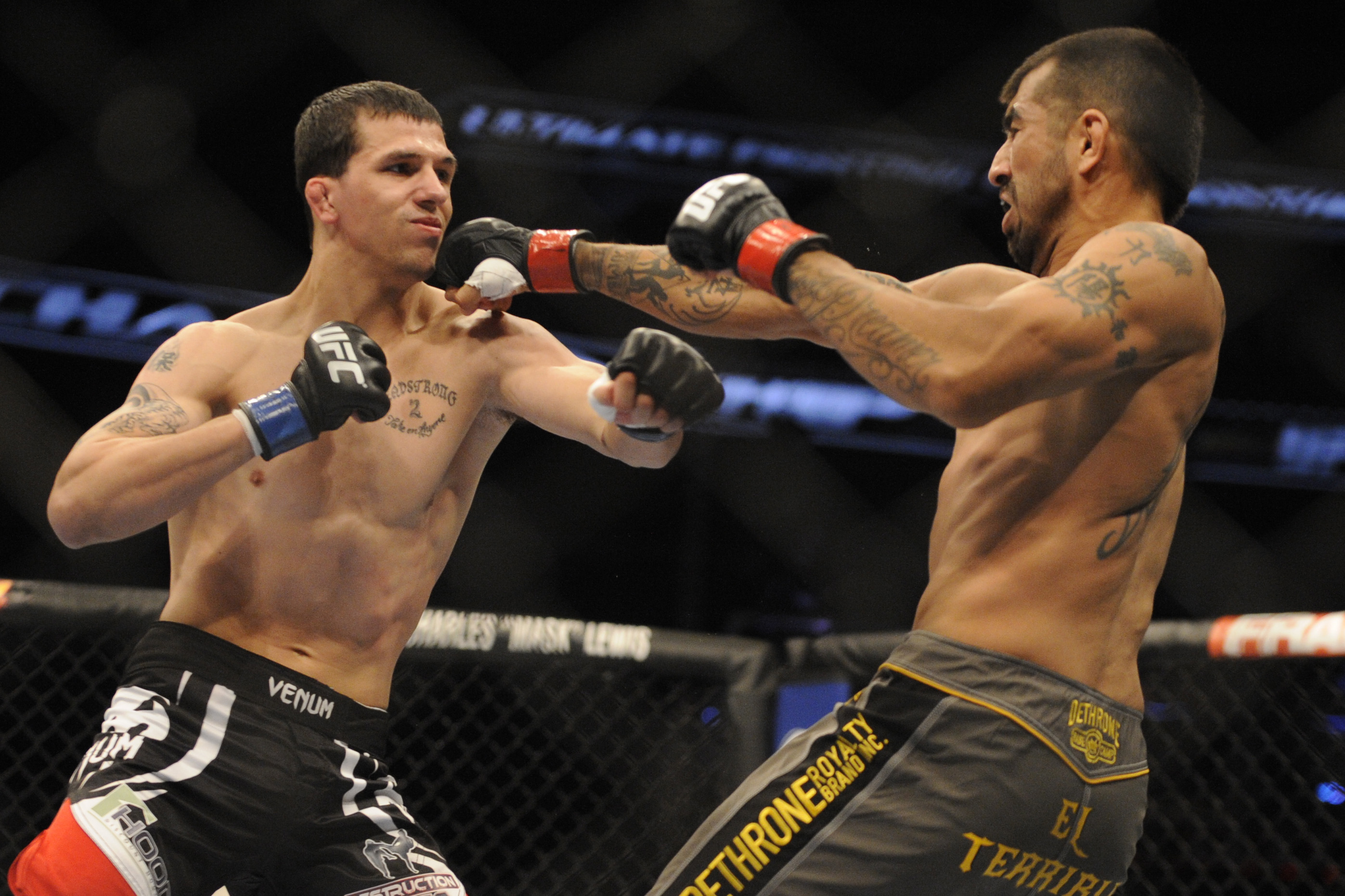 Alex White [L] balances a day job with his UFC career. (David Manning-USA TODAY Sports)