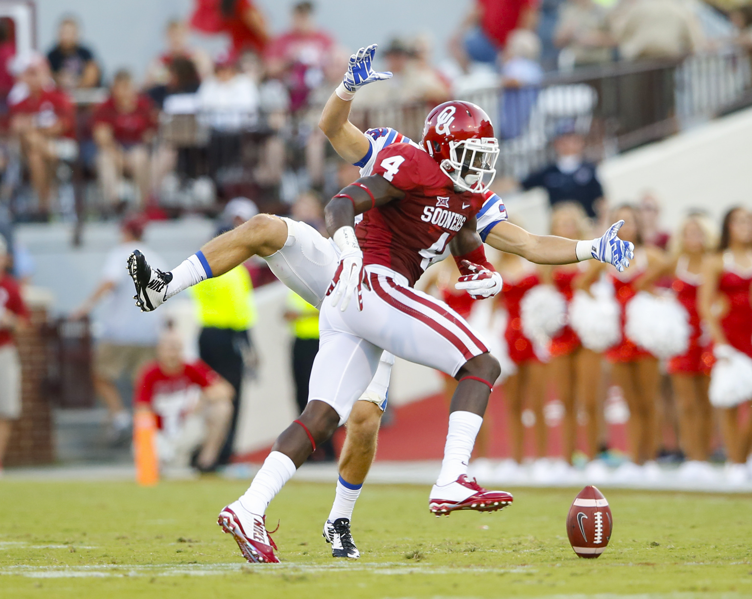 Aug 30, 2014; Norman, OK, USA; Oklahoma Sooners safety Hatari Byrd (4) knocks a pass down in front of Louisiana Tech Bulldogs running back Hunter Lee (back) during the first half at Gaylord Family - Oklahoma Memorial Stadium. (Kevin Jairaj-USA TODAY Sports)