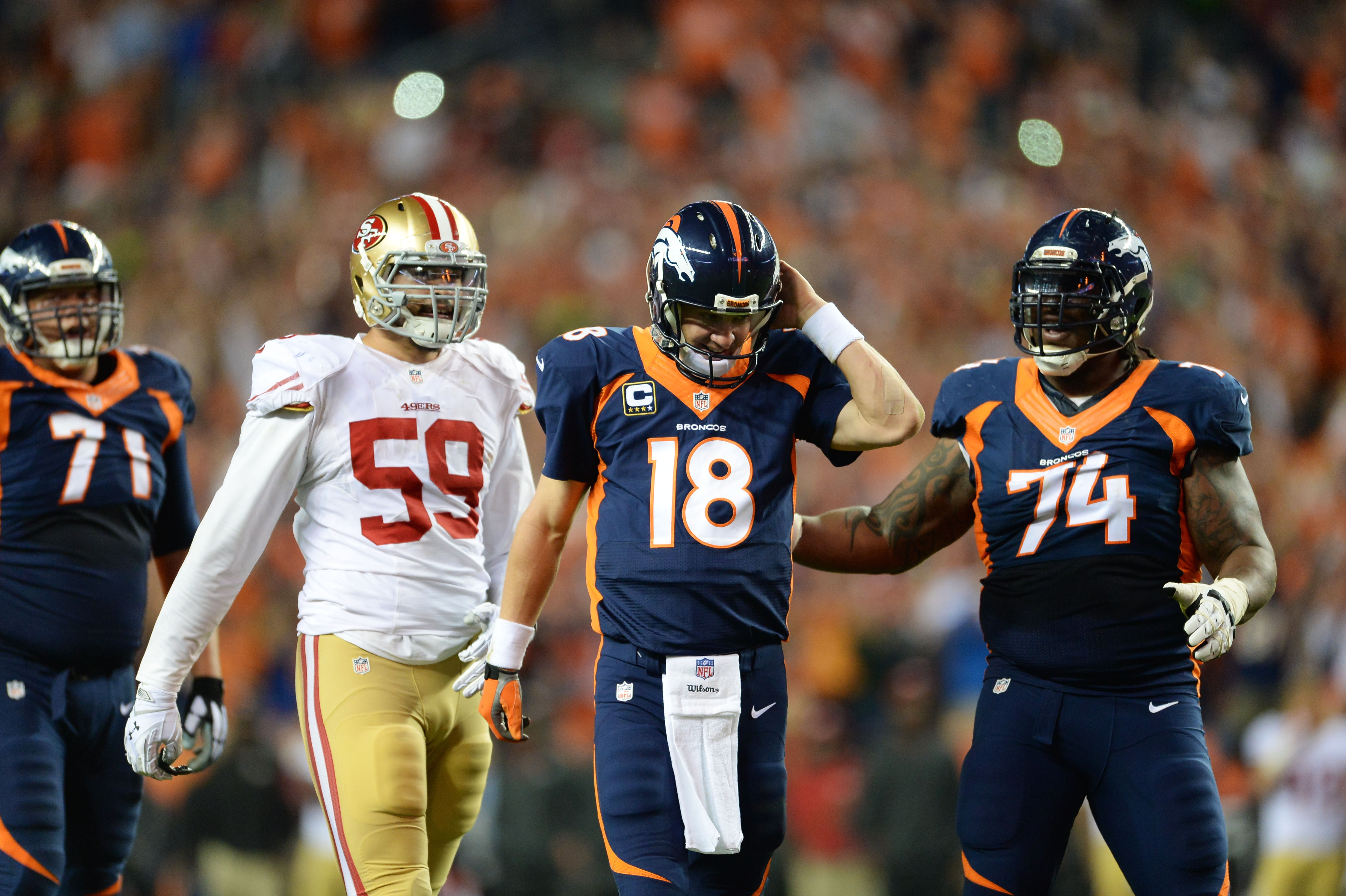 Denver Broncos guard Orlando Franklin, right, congratulates Peyton Manning on his touchdown pass. (USA Today Sports)
