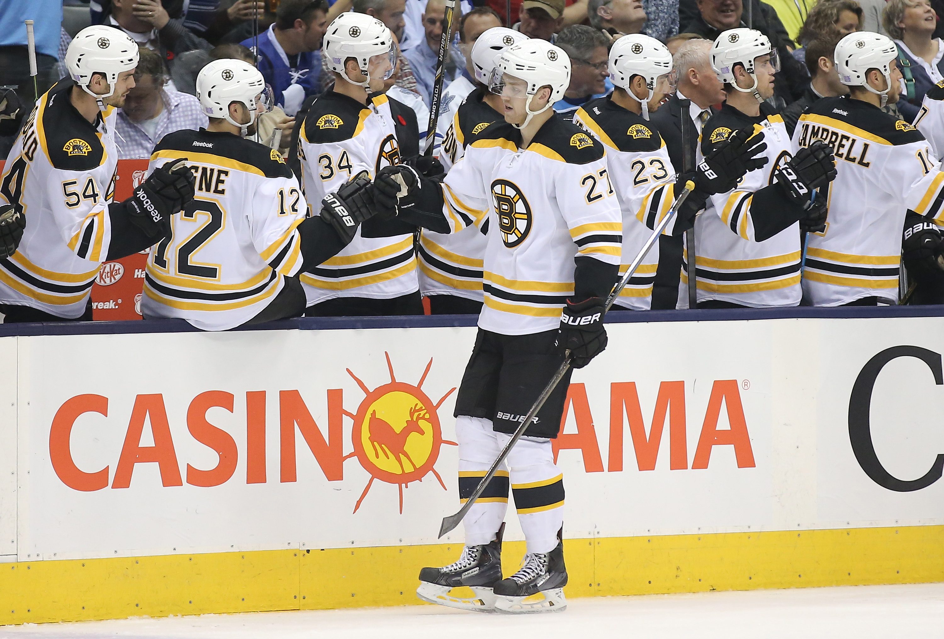 Oct 25, 2014; Toronto, Ontario, CAN; Boston Bruins defenseman Dougie Hamilton (27) is congratulated by teammates after scoring a goal in the third period against the Toronto Maple Leafs at Air Canada Centre. The Bruins beat the Maple Leafs 4-1. (Tom Szczerbowski-USA TODAY Sports)