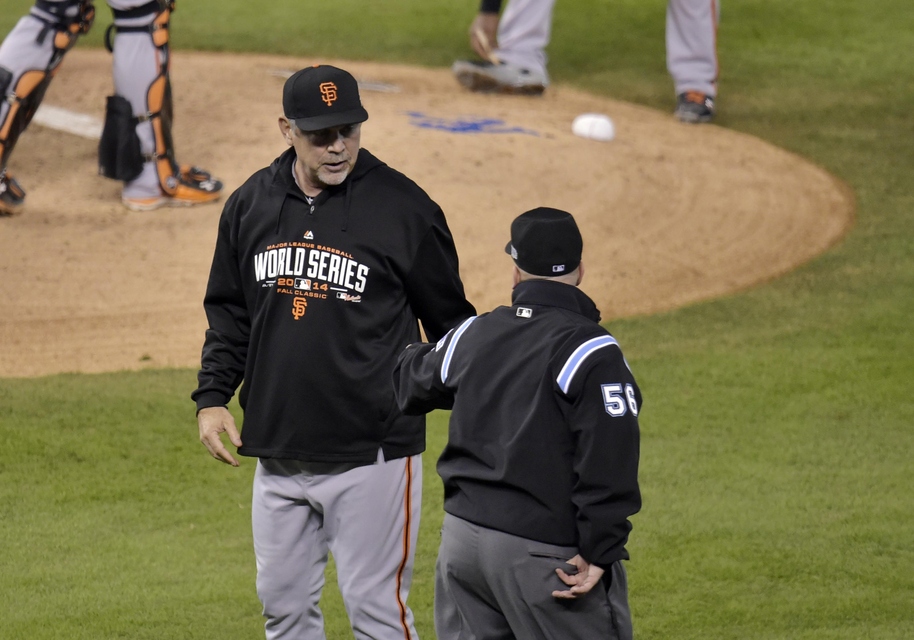 San Francisco Giants manager Bruce Bochy asks umpire Eric Cooper for a replay challenge. (USA TODAY Sports)