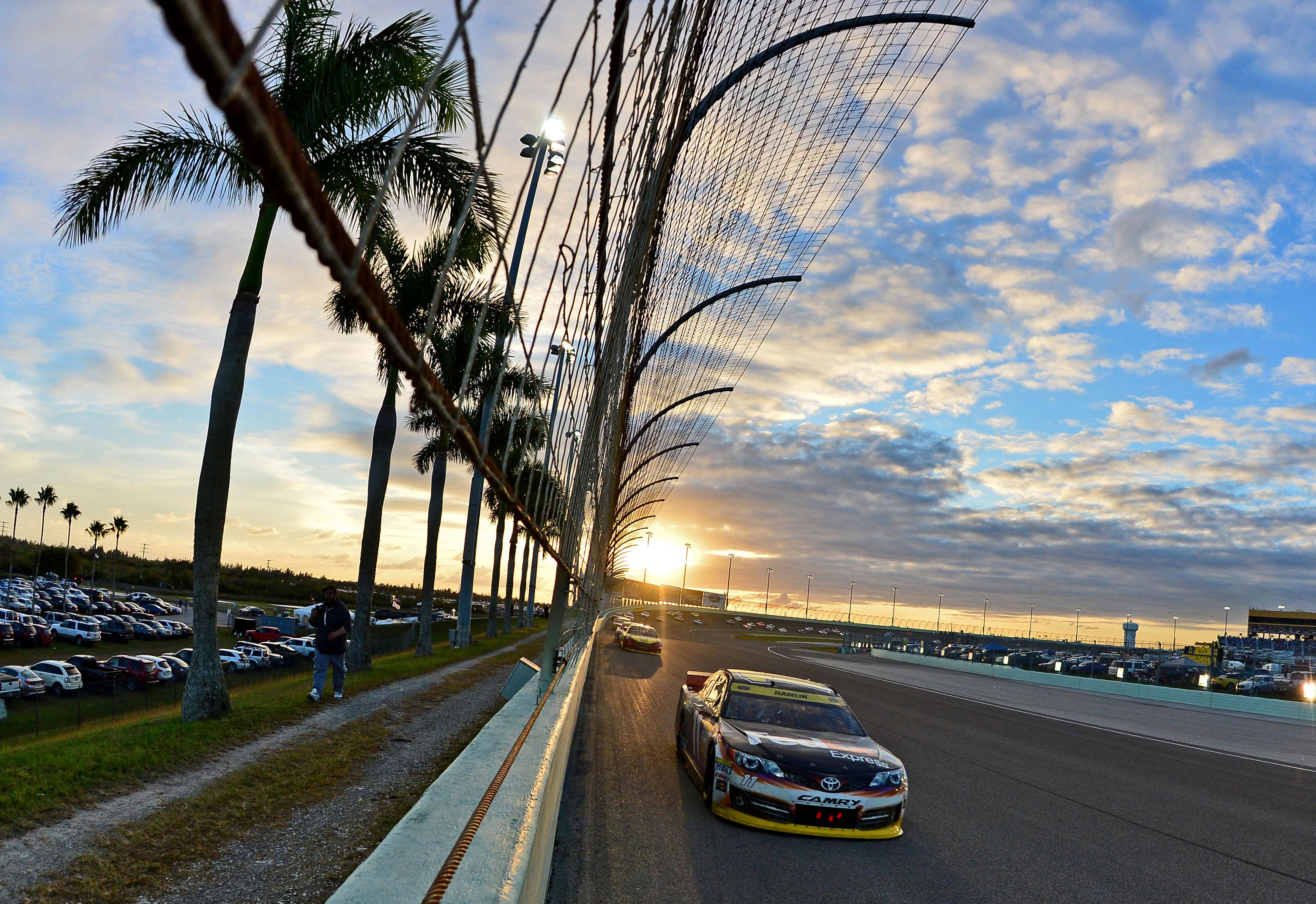 Nov 16, 2014; Homestead, FL, USA; NASCAR Sprint Cup Series driver Denny Hamlin during the Ford EcoBoost 400 at Homestead-Miami Speedway. (Andrew Weber-USA TODAY Sports)