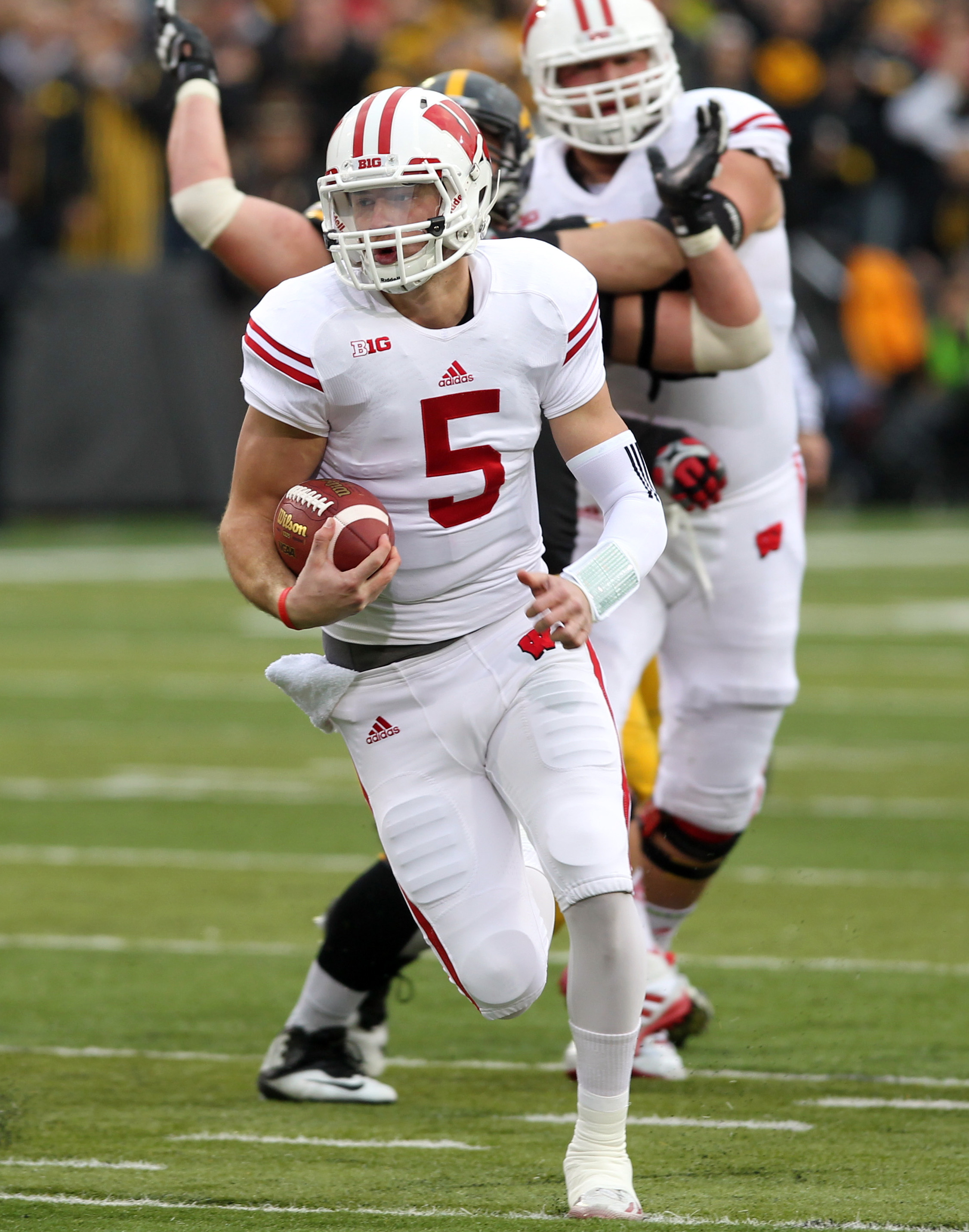 Nov 22, 2014; Iowa City, IA, USA; Wisconsin Badgers quarterback Tanner McEvoy (5) runs for a touchdown against the Iowa Hawkeyes at Kinnick Stadium. (Reese Strickland-USA TODAY Sports)