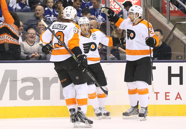 Dec 20, 2014; Toronto, Ontario, CAN; Philadelphia Flyers center Claude Giroux (28) celebrates his goal in the first period against the Toronto Maple Leafs at Air Canada Centre. (Tom Szczerbowski-USA TODAY Sports)