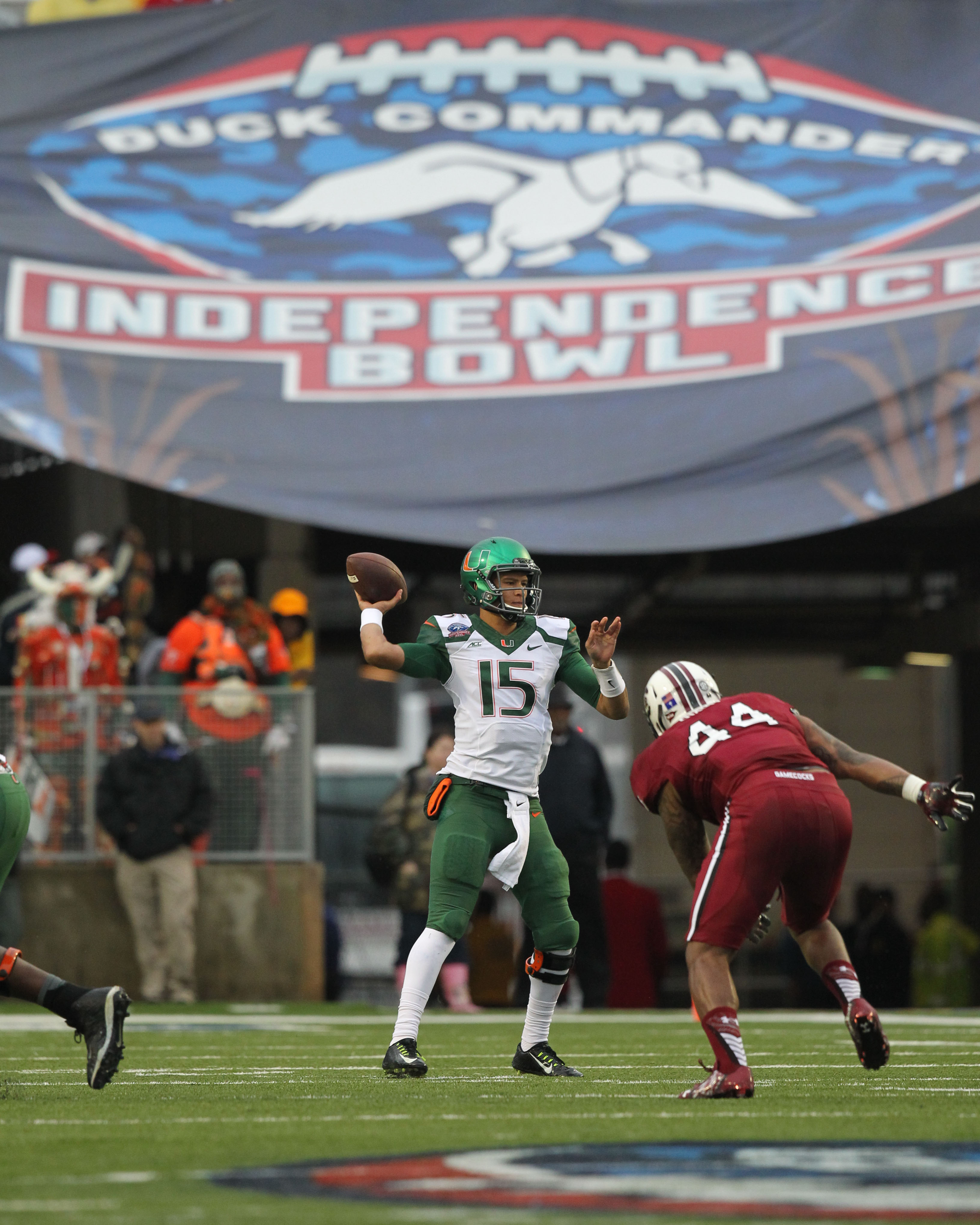 Dec 27, 2014; Shreveport, LA, USA; Miami Hurricanes quarterback Brad Kaaya (15) looks to pass as South Carolina Gamecocks defensive end Gerald Dixon (44) pressures during the first half in the 2014 Independence Bowl at Independence Stadium. (Nelson Chenault-USA TODAY Sports)
