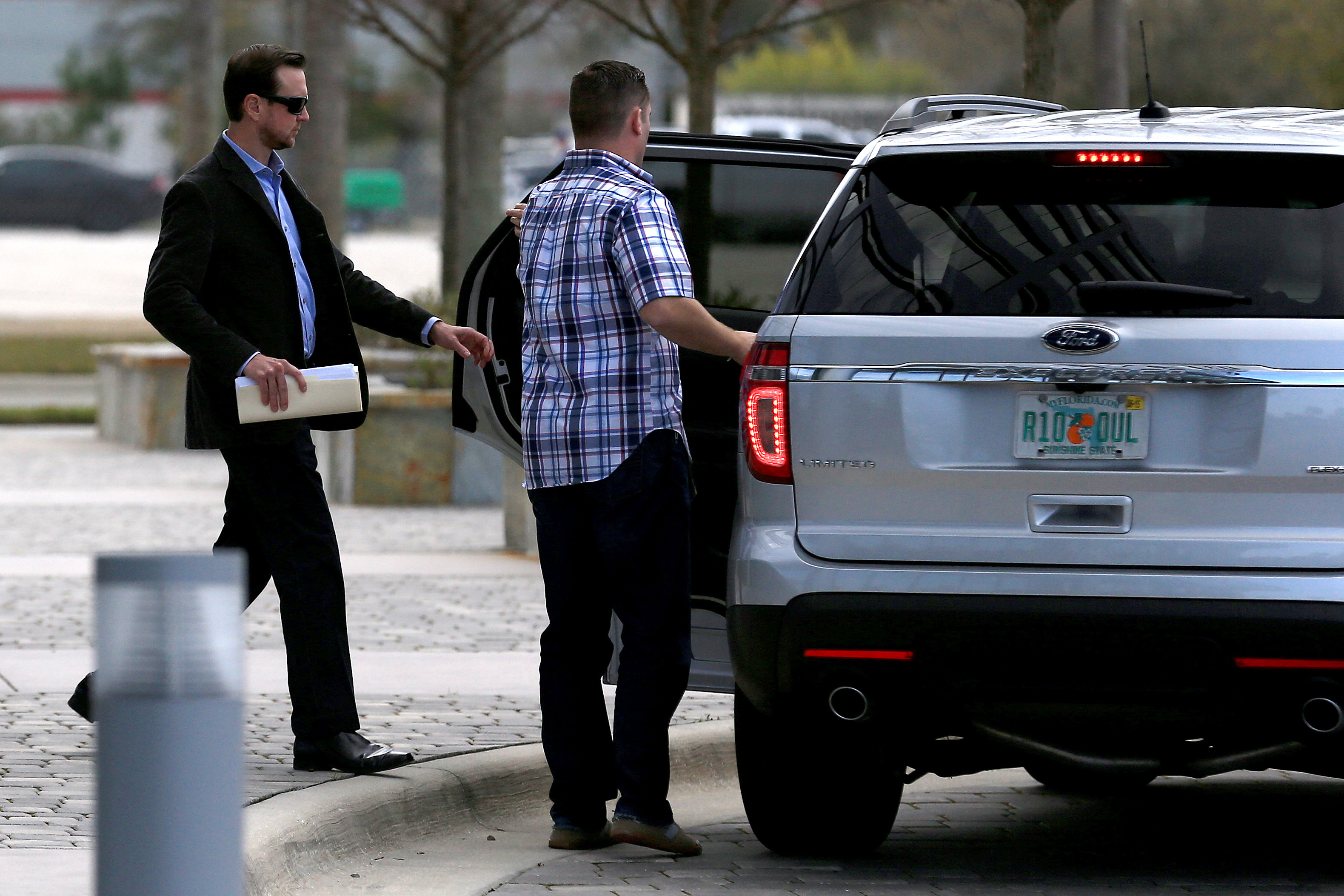Kurt Busch leaves his appeal hearing at NASCAR headquarters. (USAT)