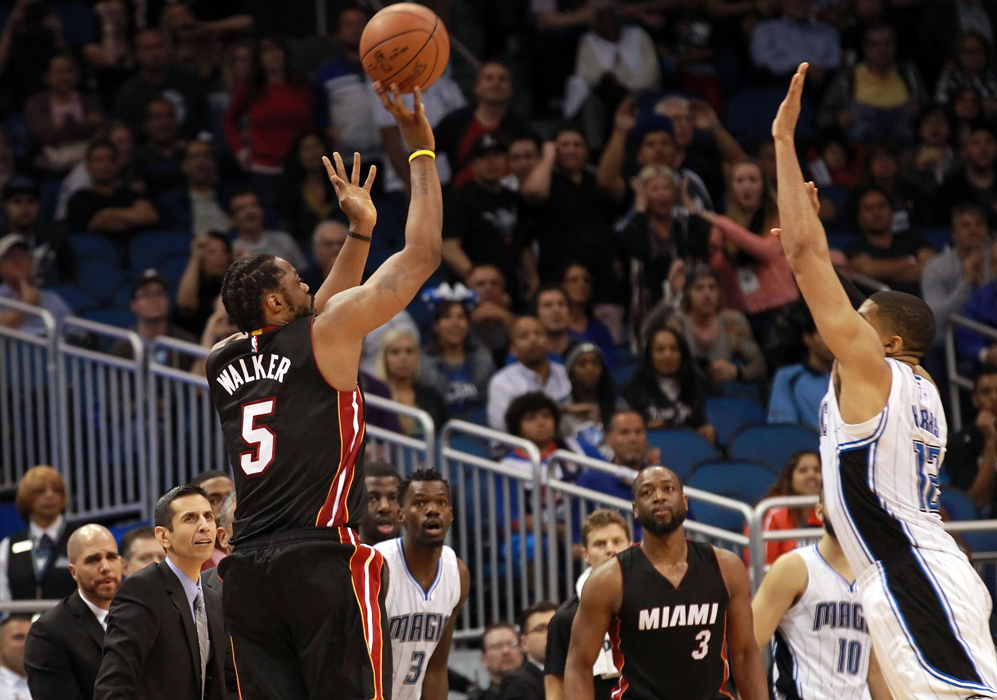 Henry Walker's two 3-pointers in final :22 force OT, push Heat …