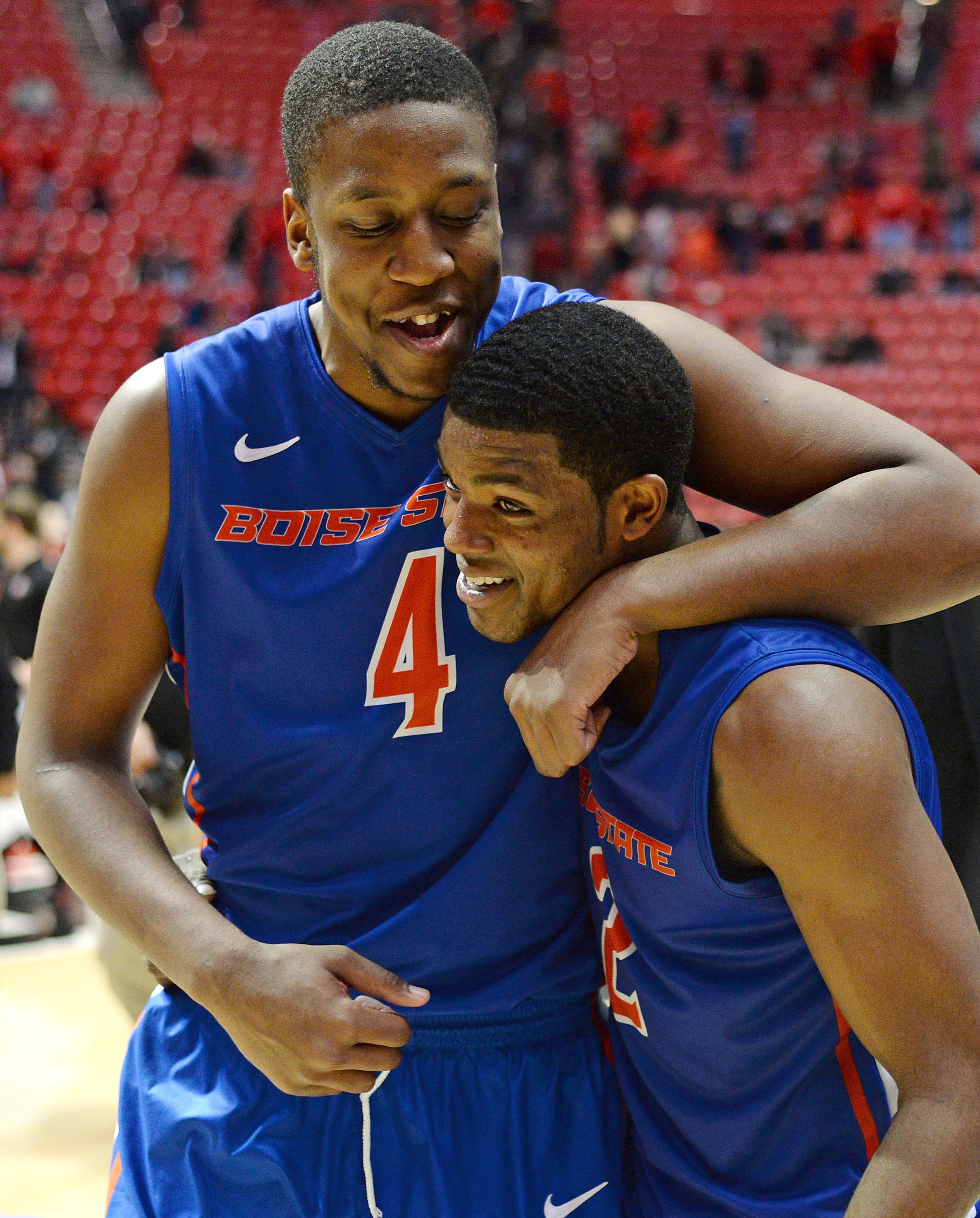 Feb 28, 2015; San Diego, CA, USA; Boise State Broncos center Kevin Allen (4) hugs guard Derrick Marks (2) after the Broncos defeated the San Diego State Aztecs 56-46 at Viejas Arena at Aztec Bowl. (Jake Roth-USA TODAY Sports)