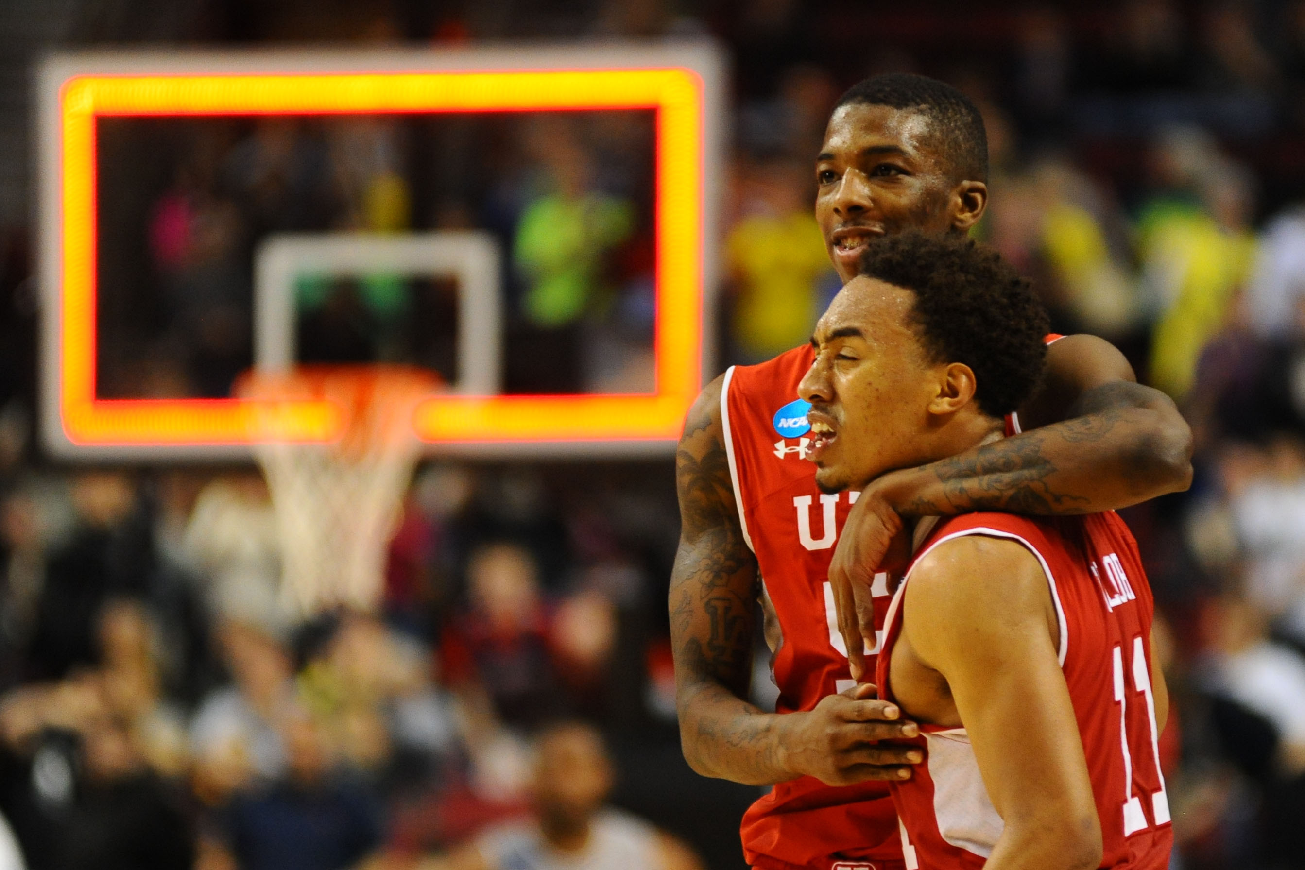 Delon Wright (back) and guard Brandon Taylor (11) celebrate after beating Georgetown. (USAT)