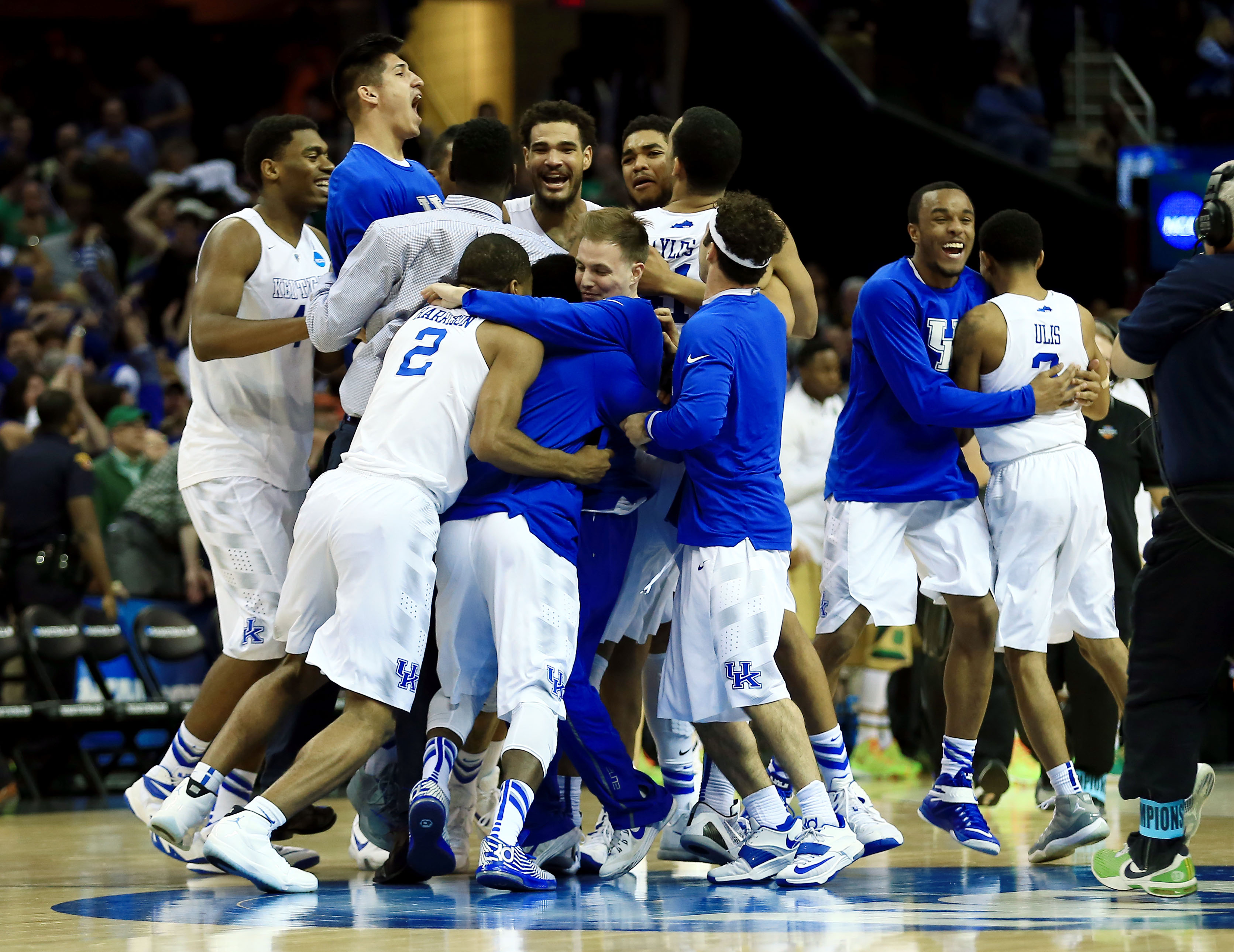 Mar 28, 2015; Cleveland, OH, USA; Kentucky Wildcats celebrate after the game against the Notre Dame Fighting Irish in the finals of the midwest regional of the 2015 NCAA Tournament at Quicken Loans Arena. Kentucky won 68-66. (Andrew Weber-USA TODAY Sports)
